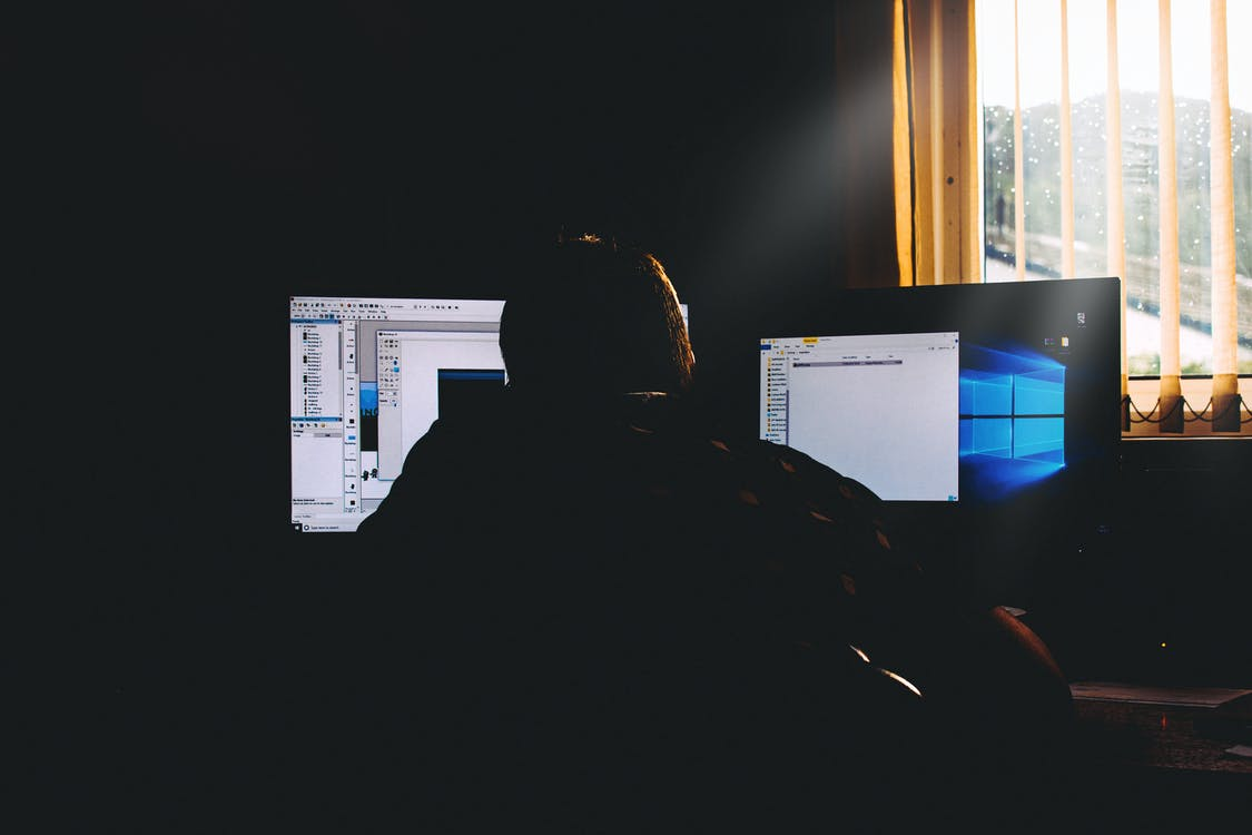 Man Using Computers