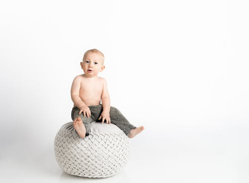 Child Sitting on White Stool