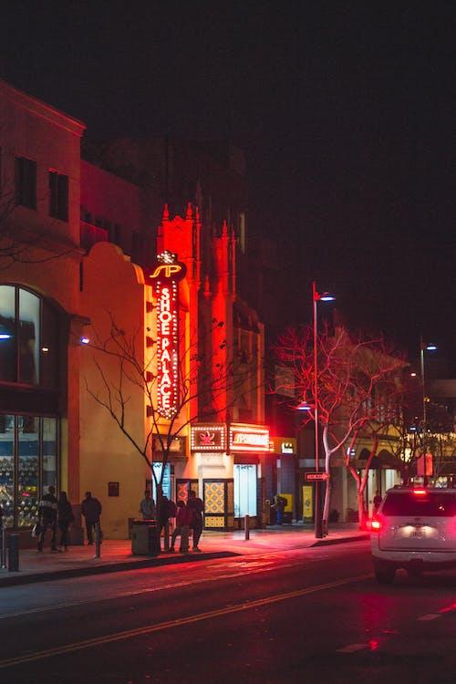 People On Sidewalk Near Road At Night