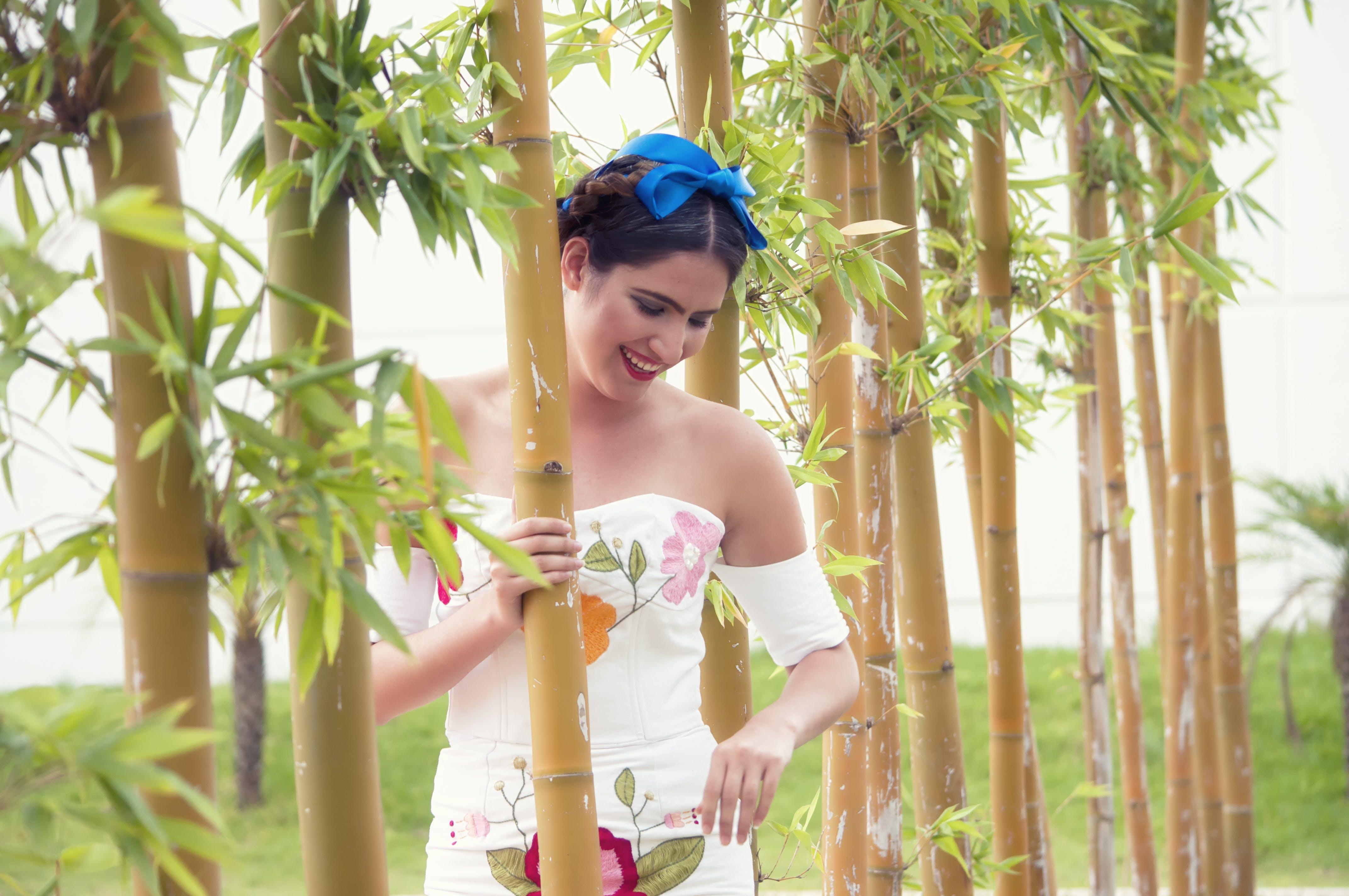 Woman Behind Bamboo Grass
