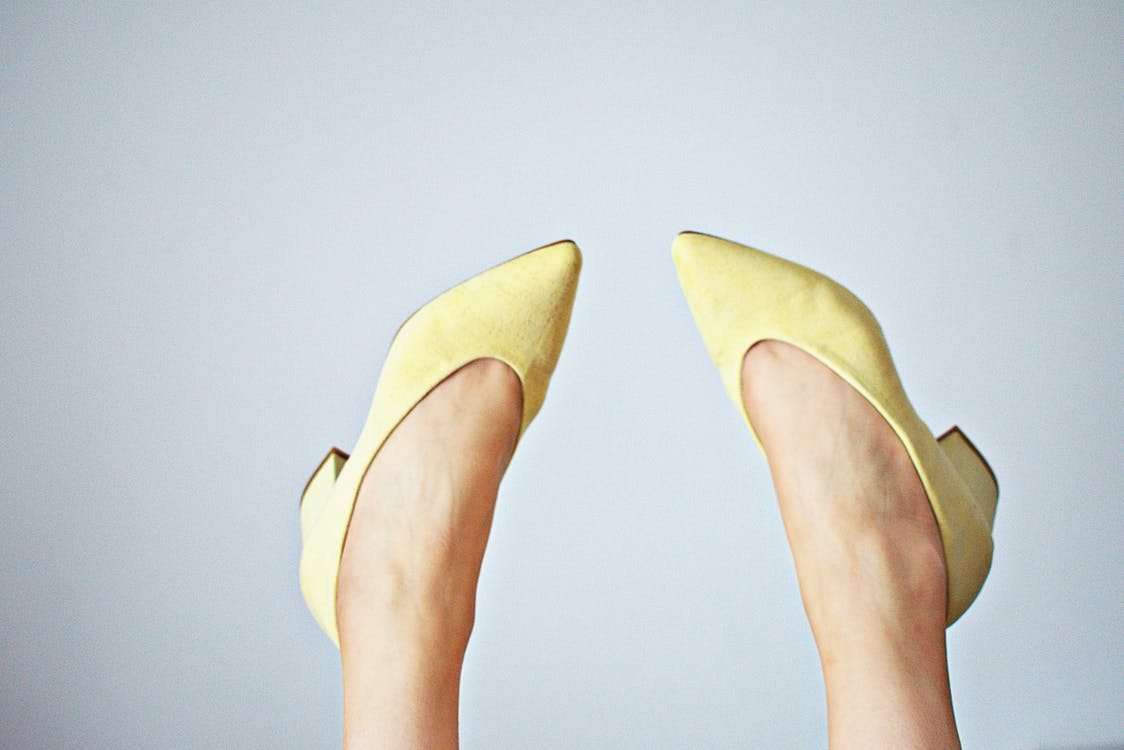 Woman Wearing Yellow Pointed-toe Pumps
