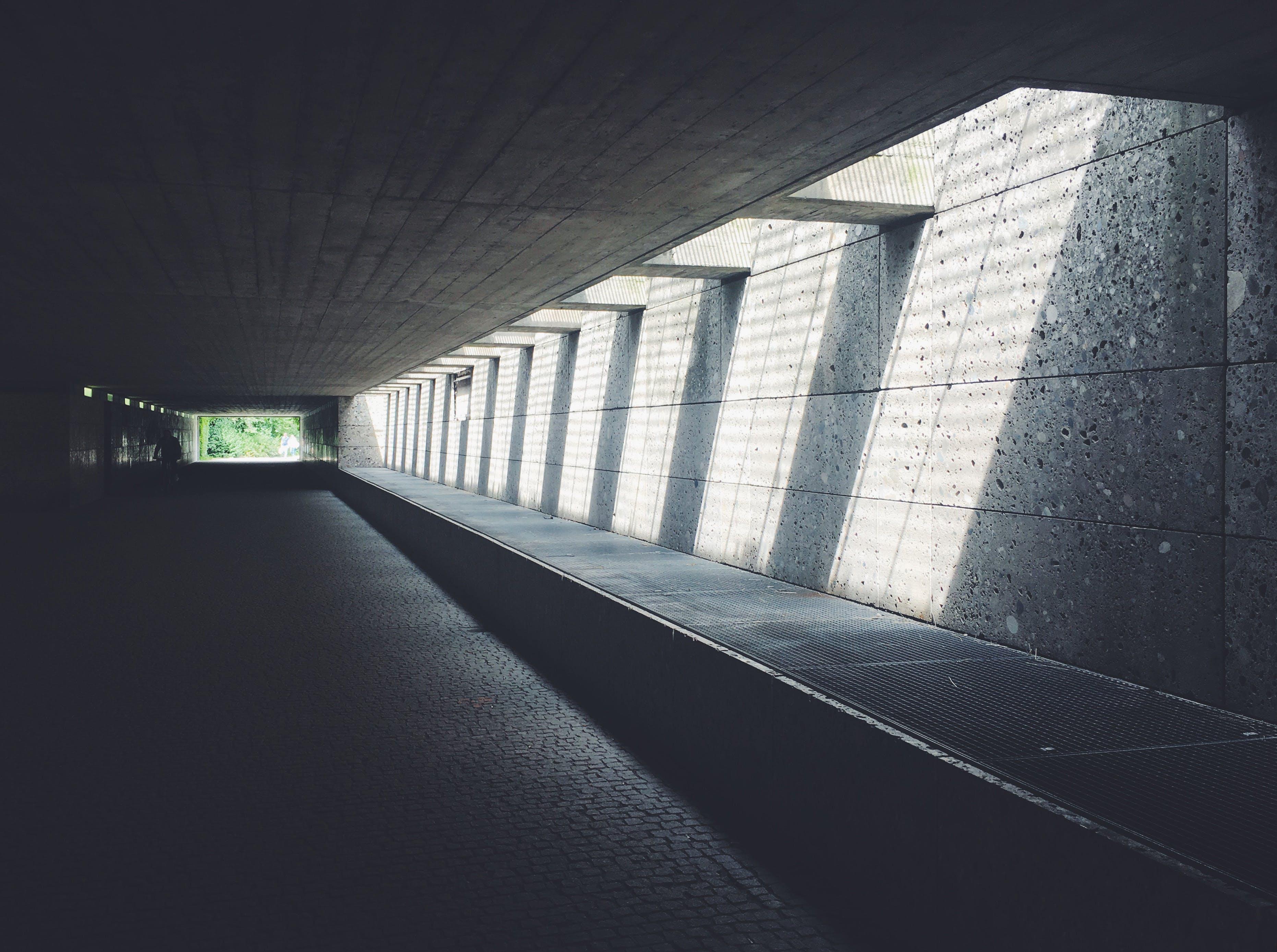 Sunlight Streaming Through Concrete Opening of Underground Passageway