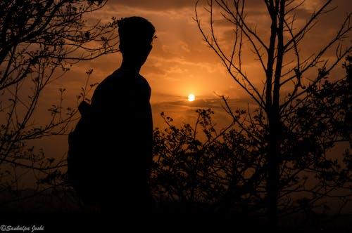Foto profissional grátis de amador, aventura, céu alaranjado, crepúsculo