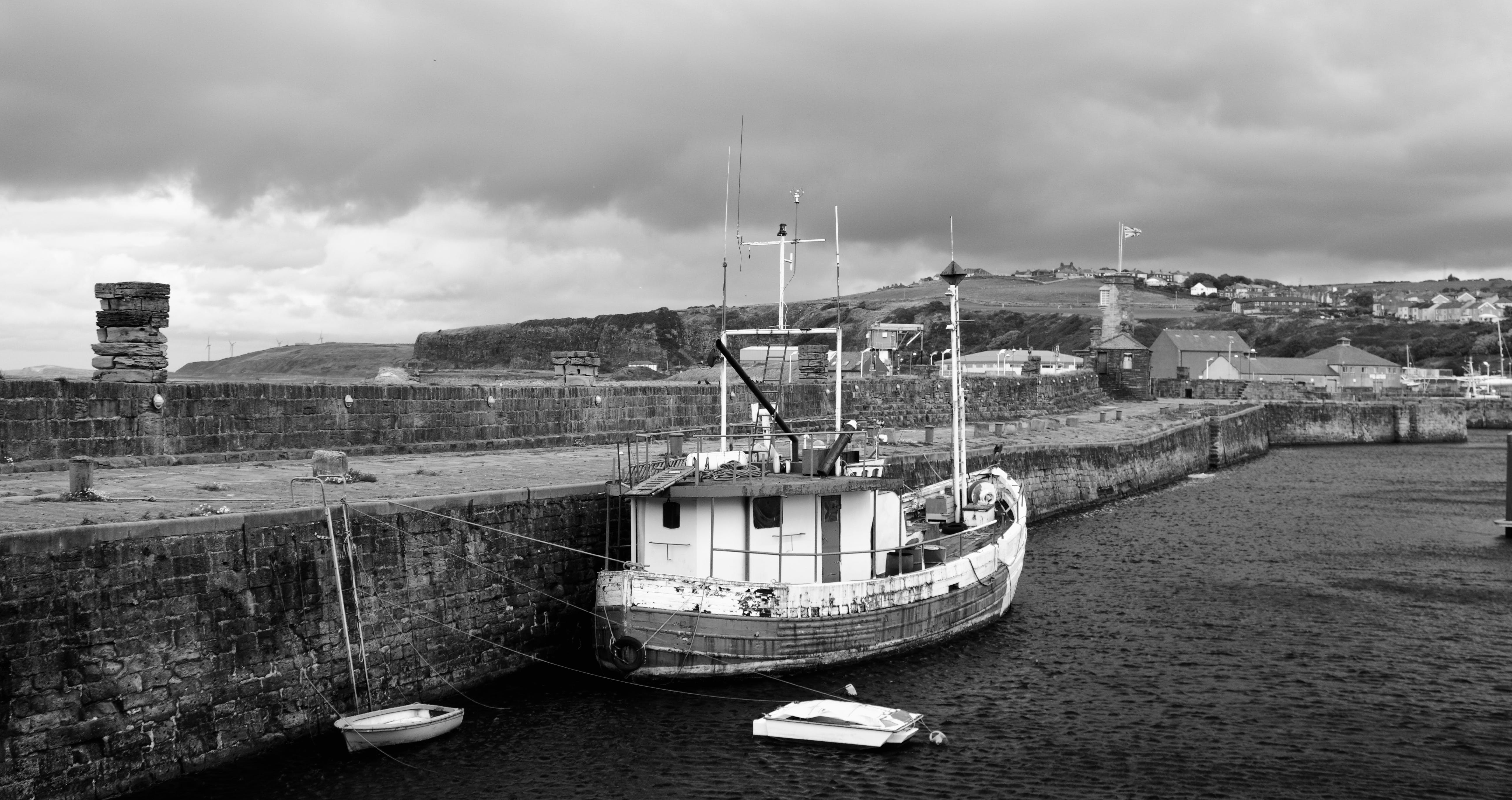Grayscale Photography of Boat on Dockj