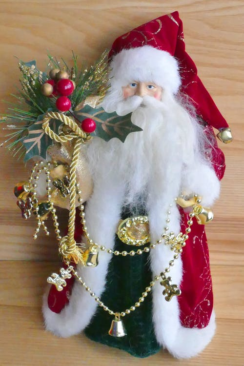 Santa Claus Holding Mistletoe Ornament