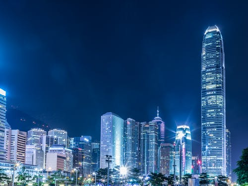Lighted High-rise Buildings At Night Time