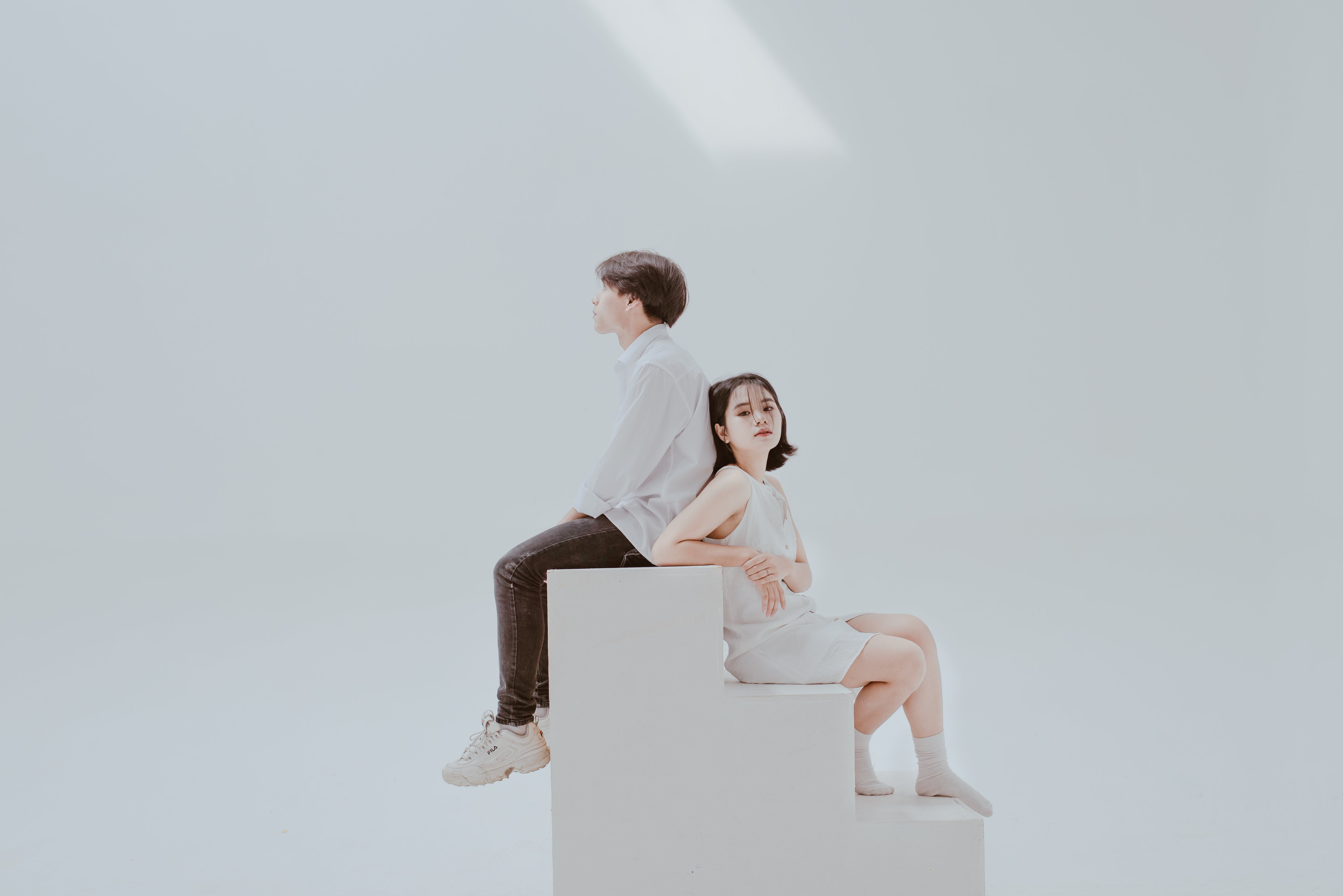 Photo of Woman Sitting on Staircase Beside Man