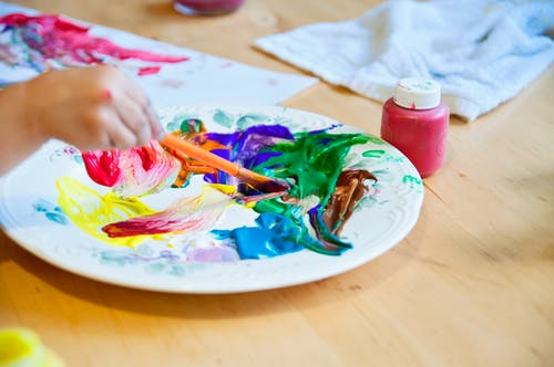 Free stock photo of arts and crafts, bright colours, child's hand, color palette
