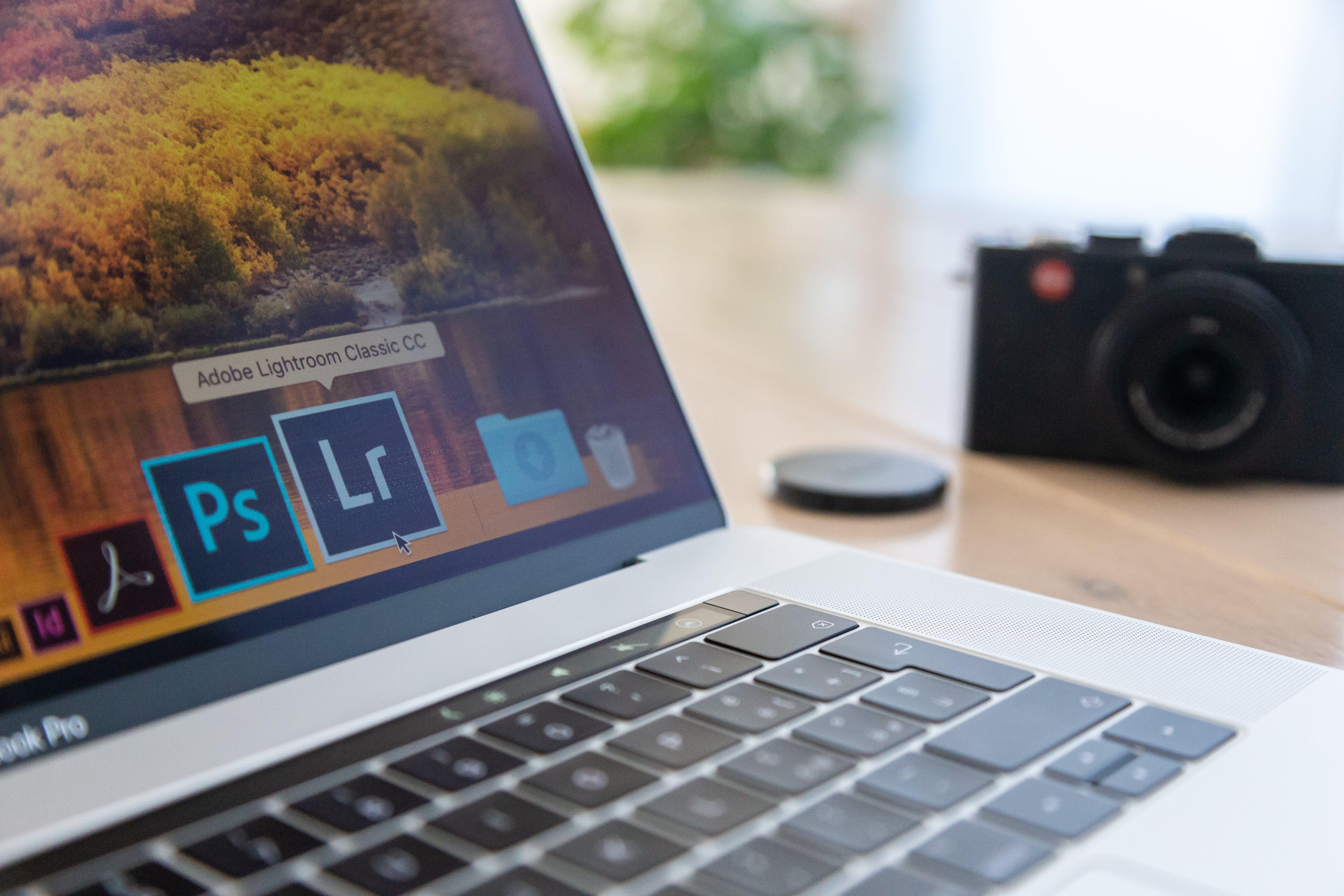 Selective Focus Photography of Macbook Pro Near Film Camera