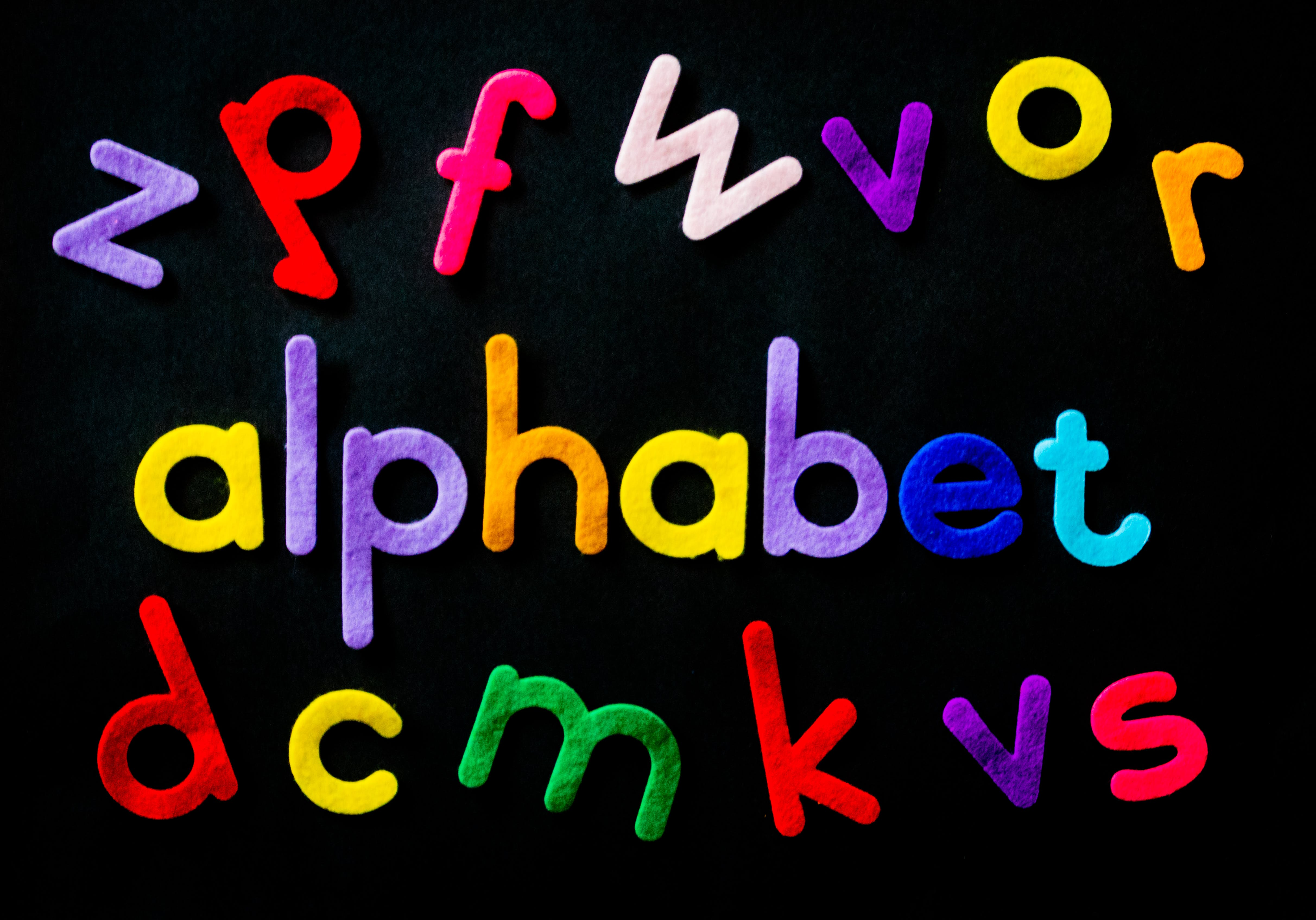 Assorted-color Alphabet on Black Background