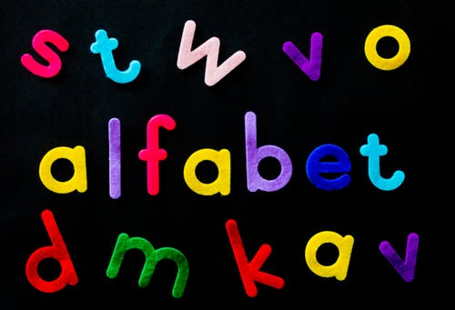 Assorted-color Alfabet Letters on Black Background