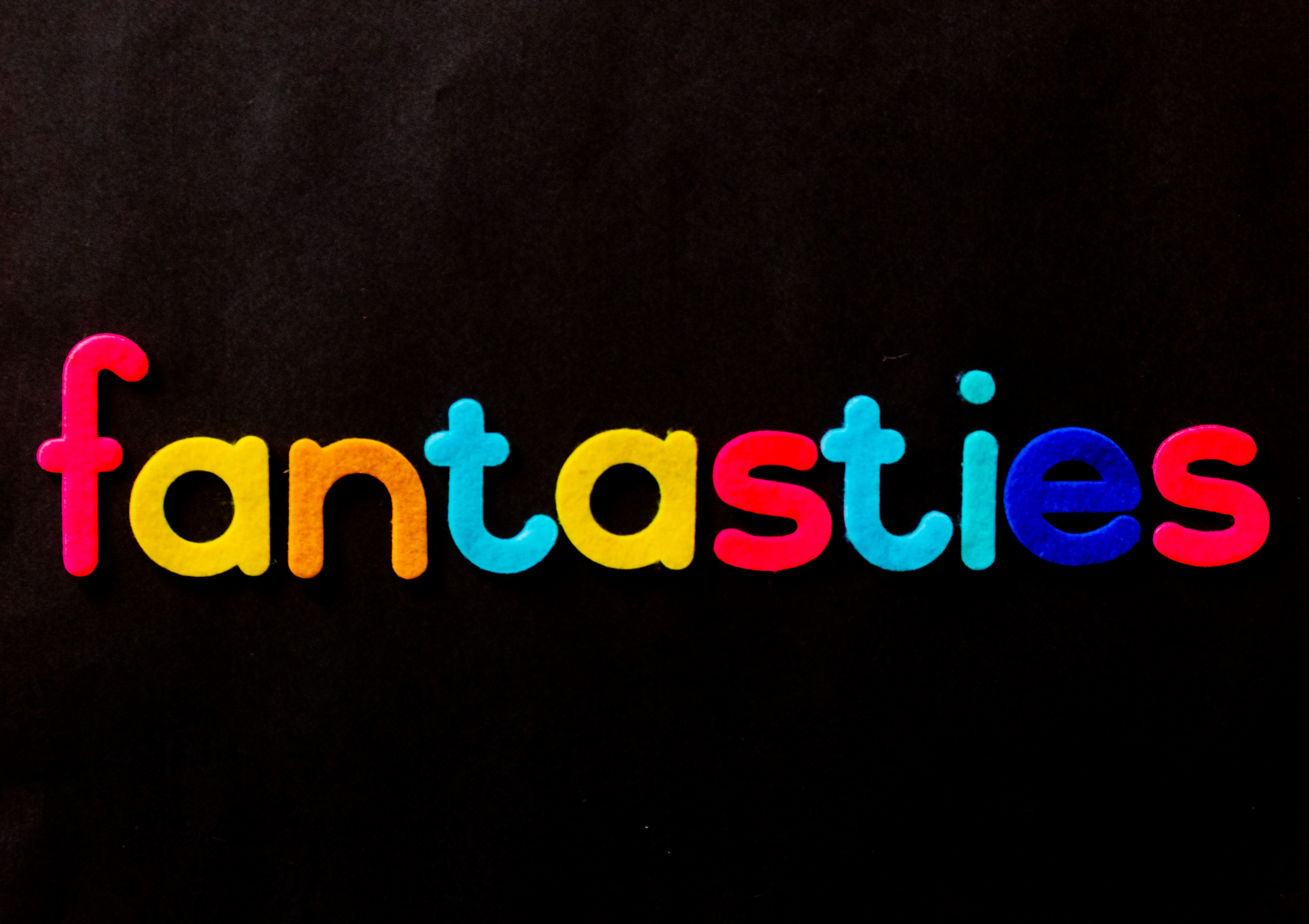 Black Background With Fantasties Text Overlay