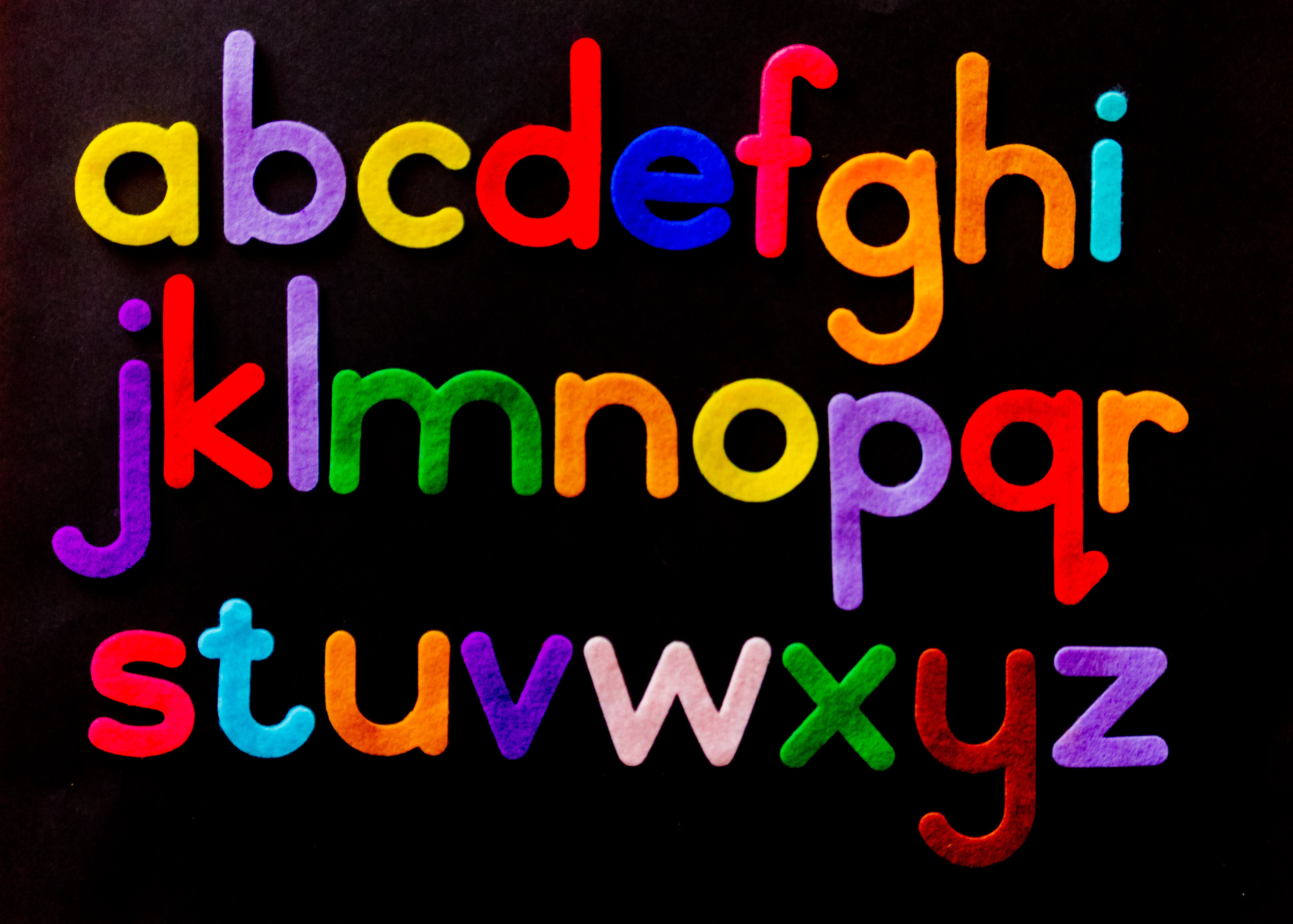 Alphabet letters on black background