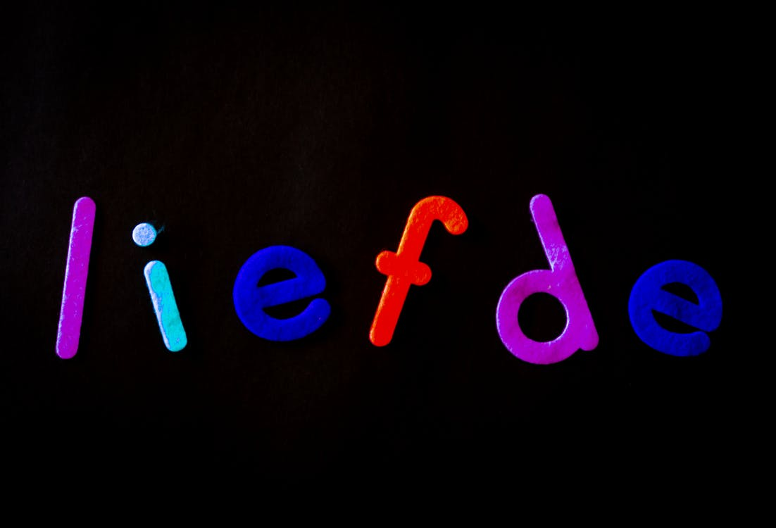 Black Background With Liefde Text Overlay