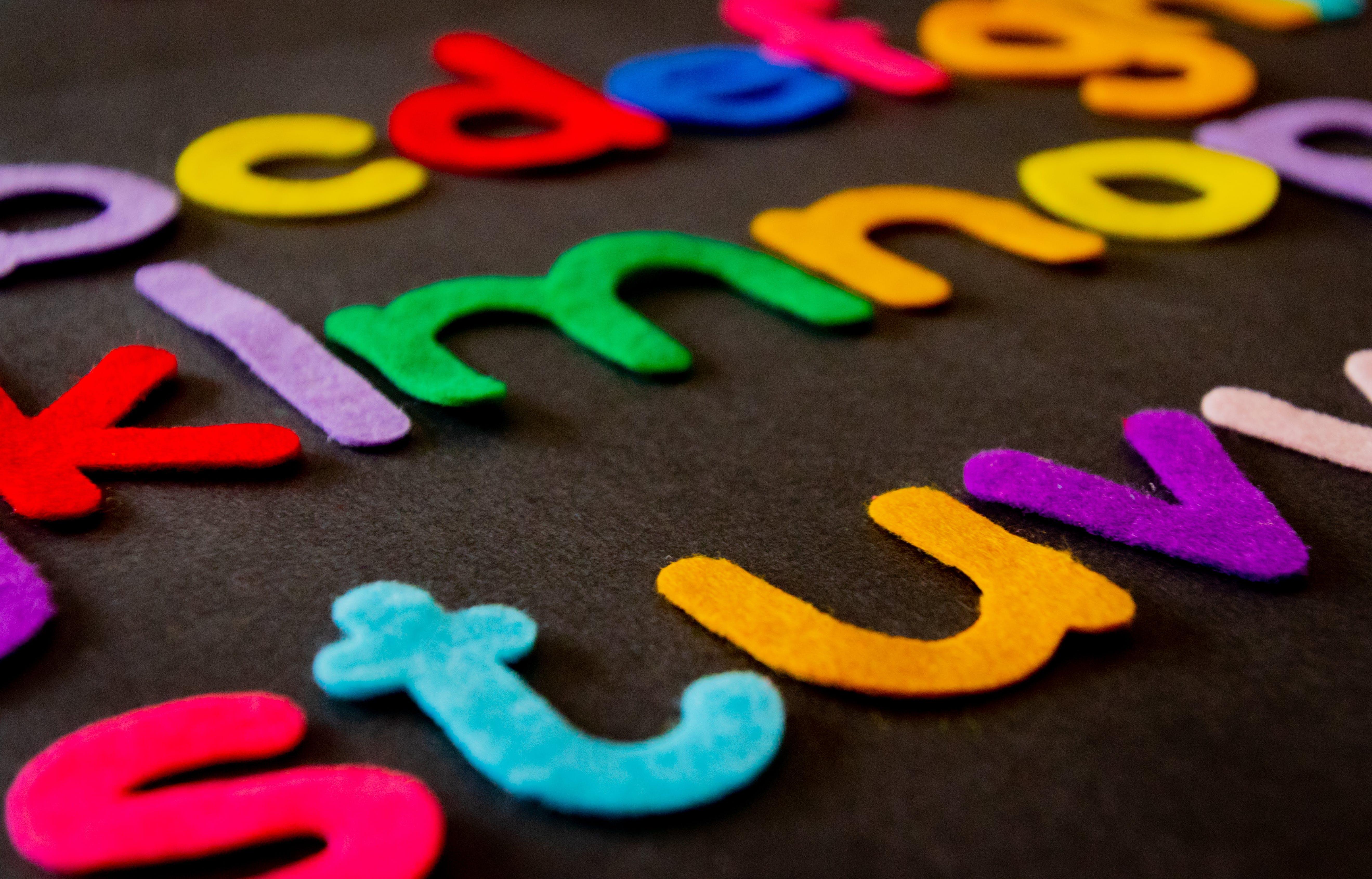 Closeup Photo of Assorted-color Alphabets