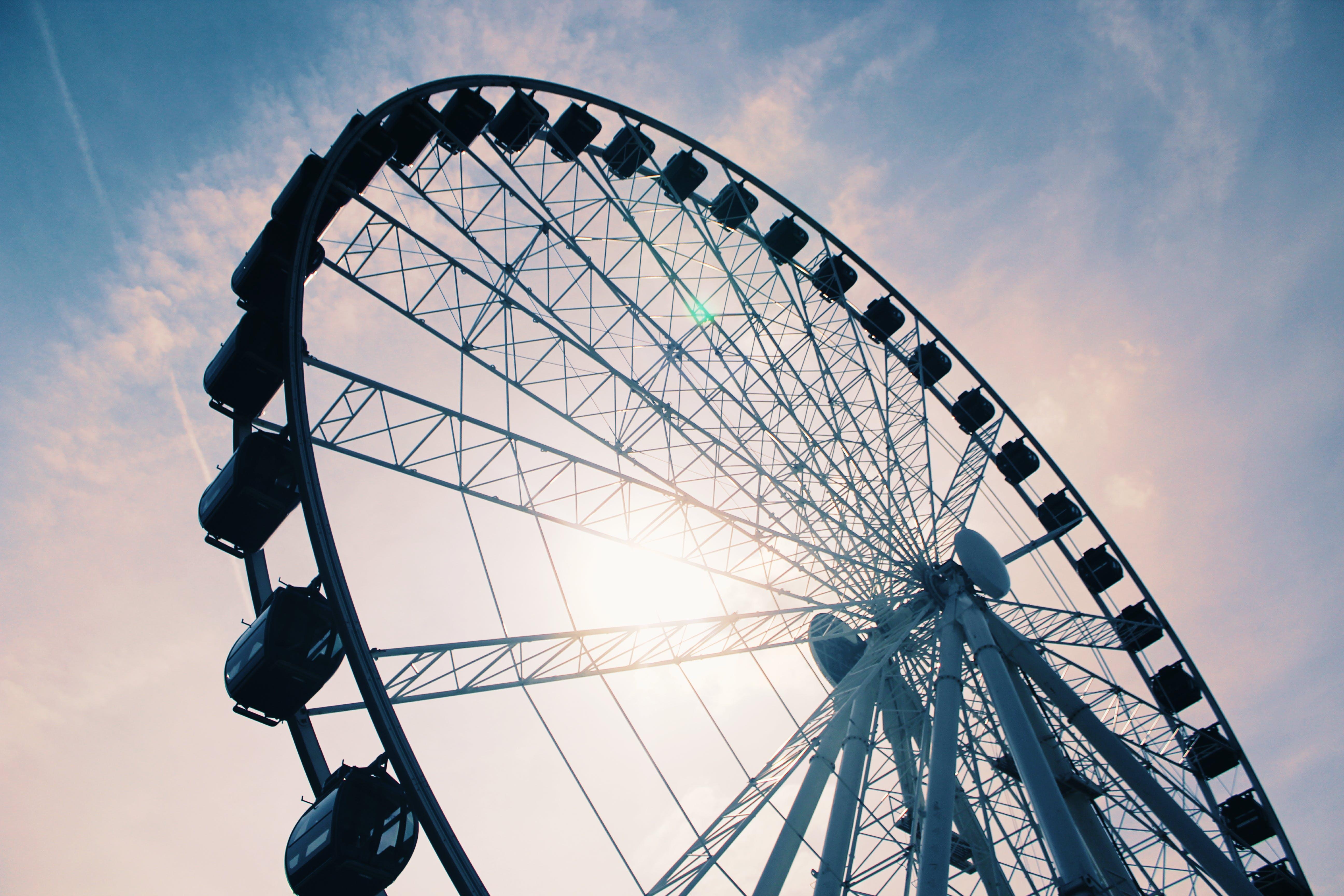 White Ferris Wheel Under Cloudy Sky
