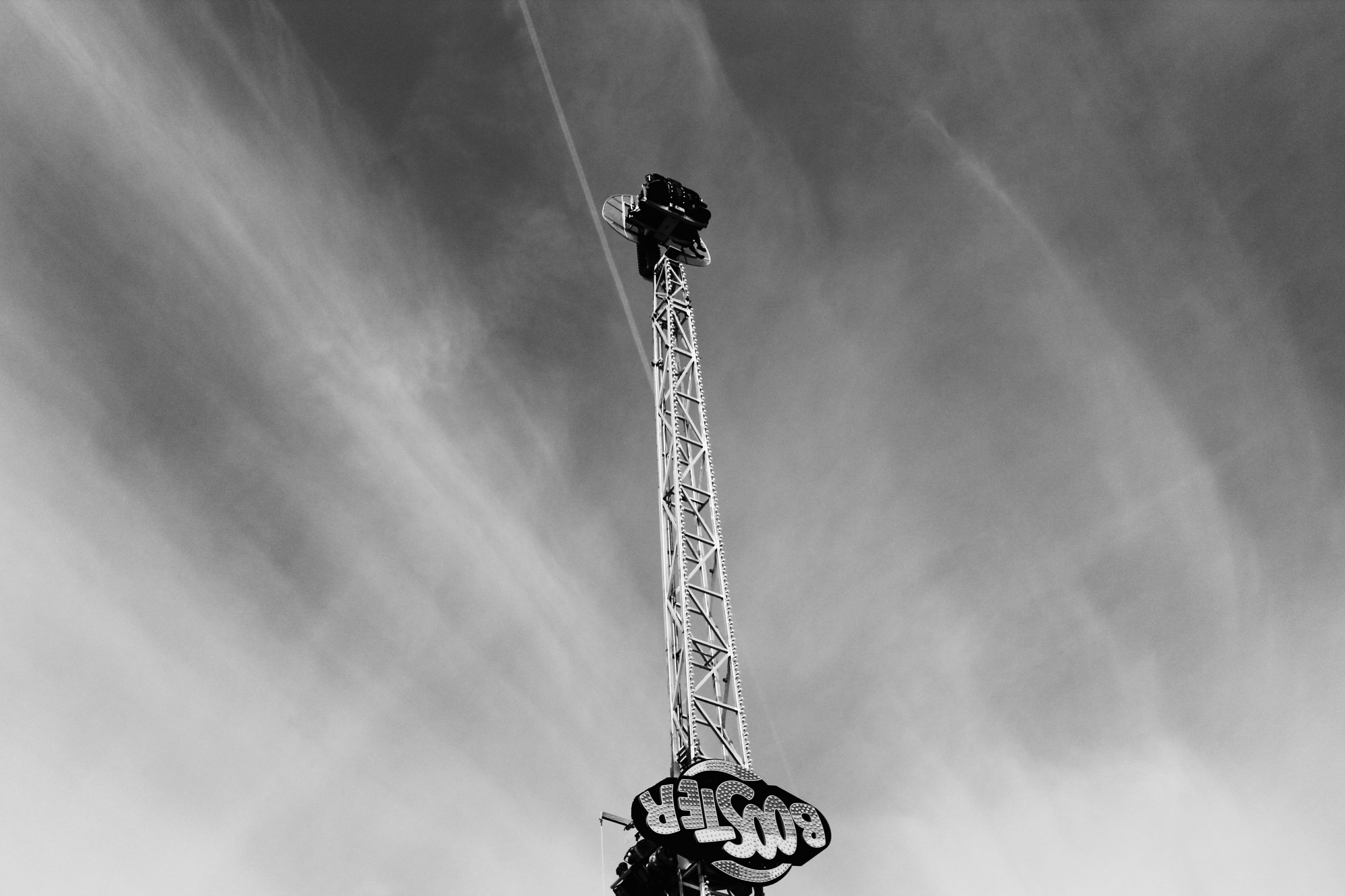Grayscale Photography of Booster Crane