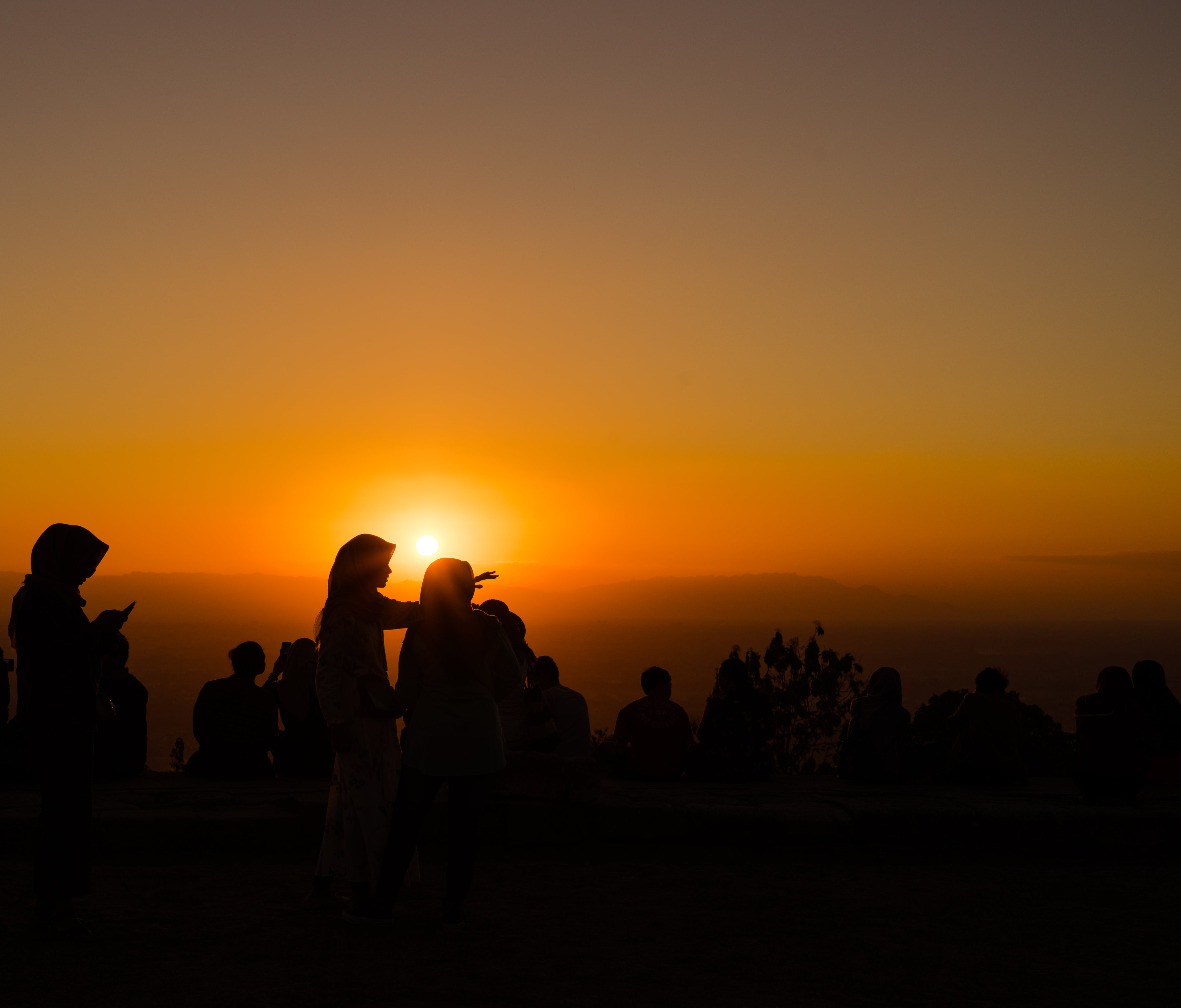 Silhouette Photograph of Several People during Golden Hour