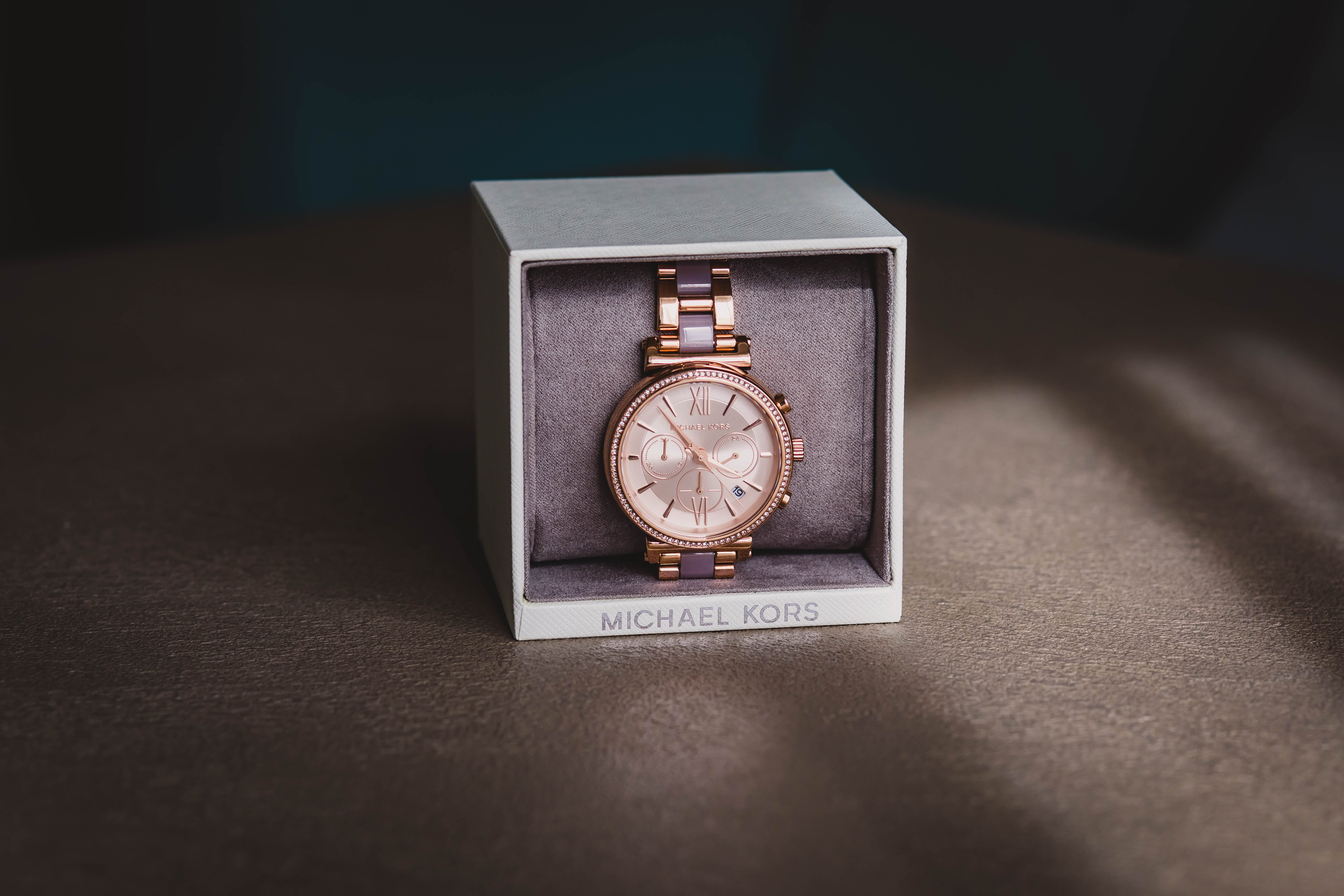 Round Gold-colored Analog Watch With Link Bracelet and Box