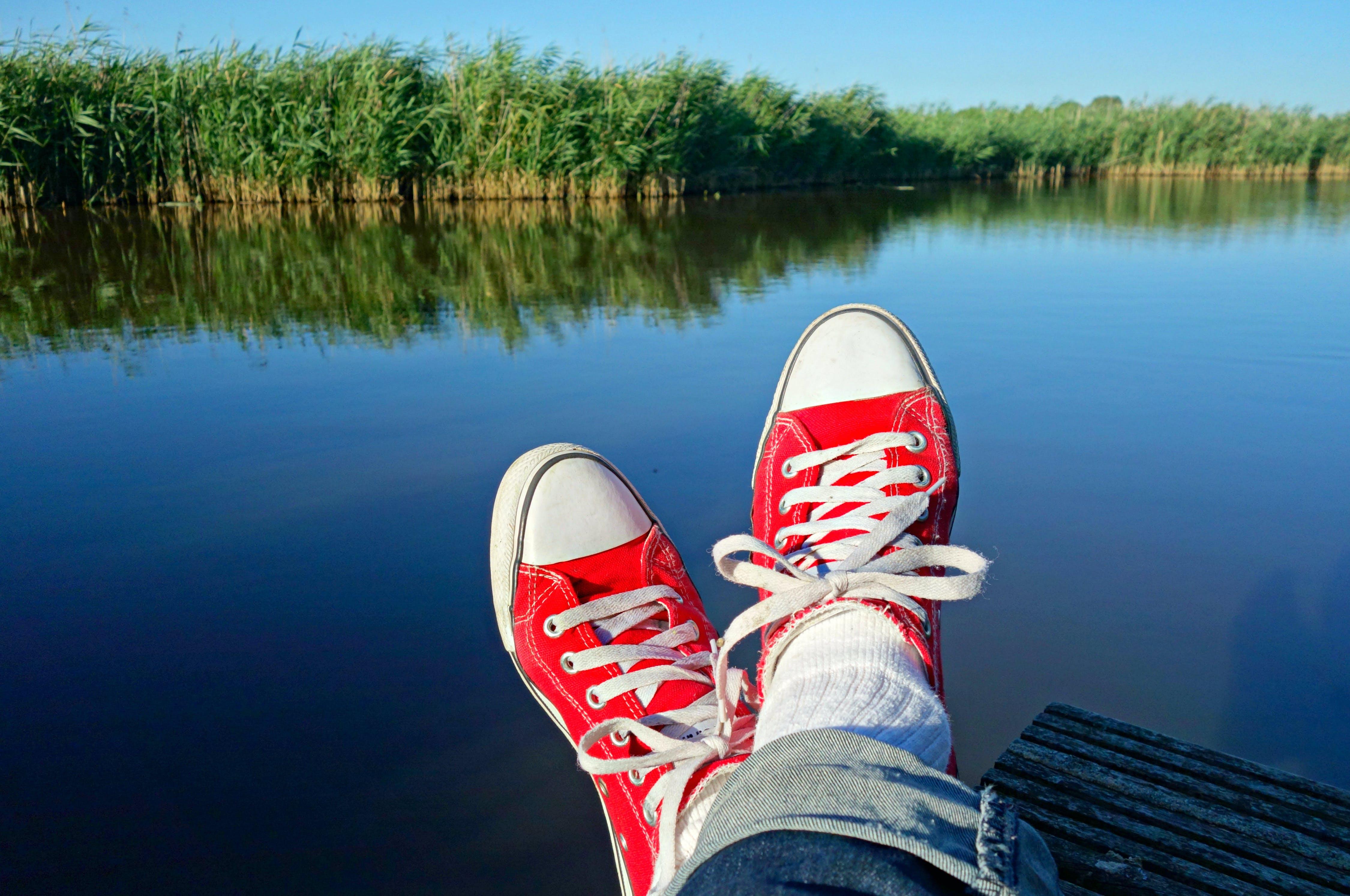 of crossed feet, feet, female, jetty