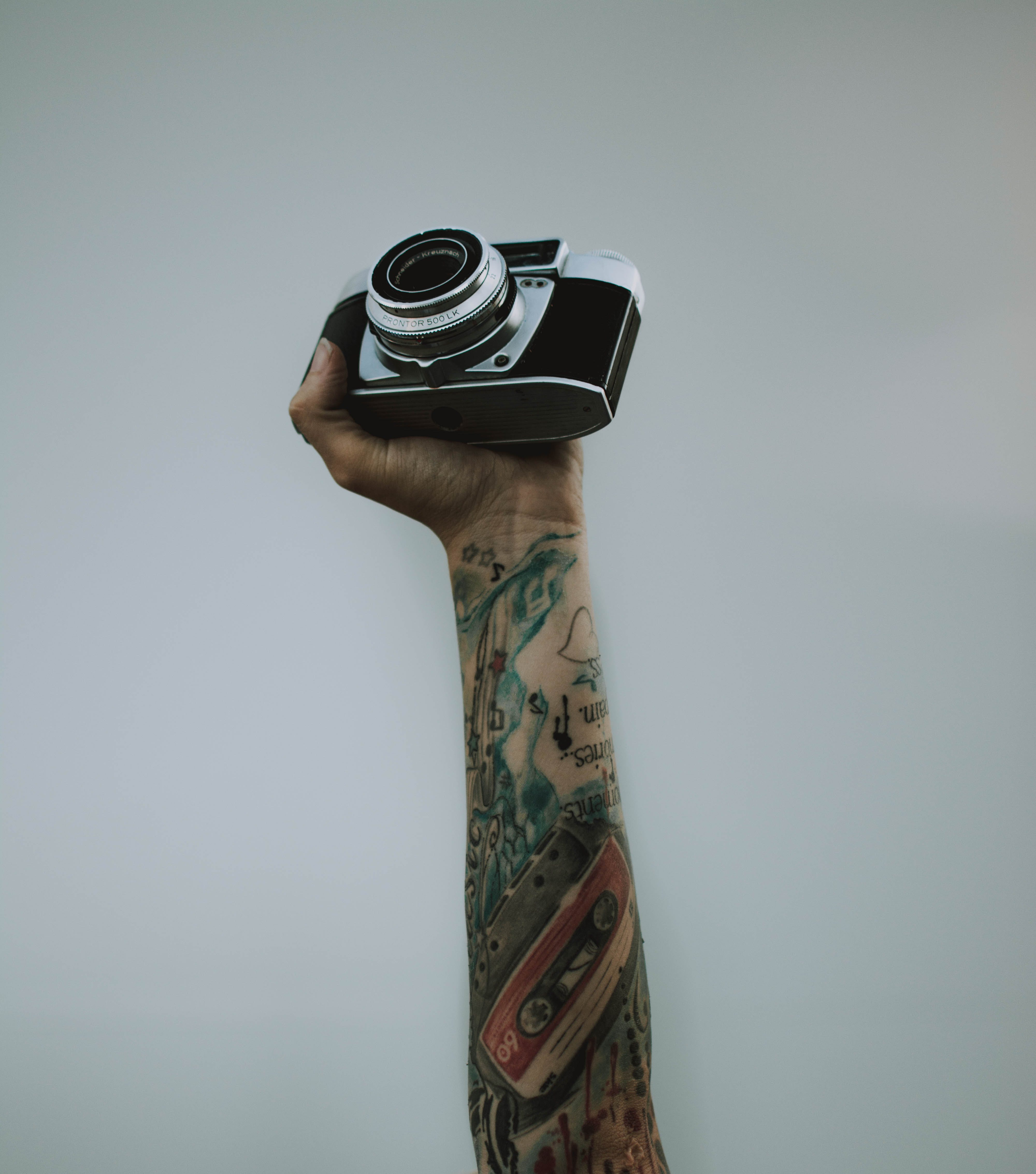 Person Holding Slr Camera