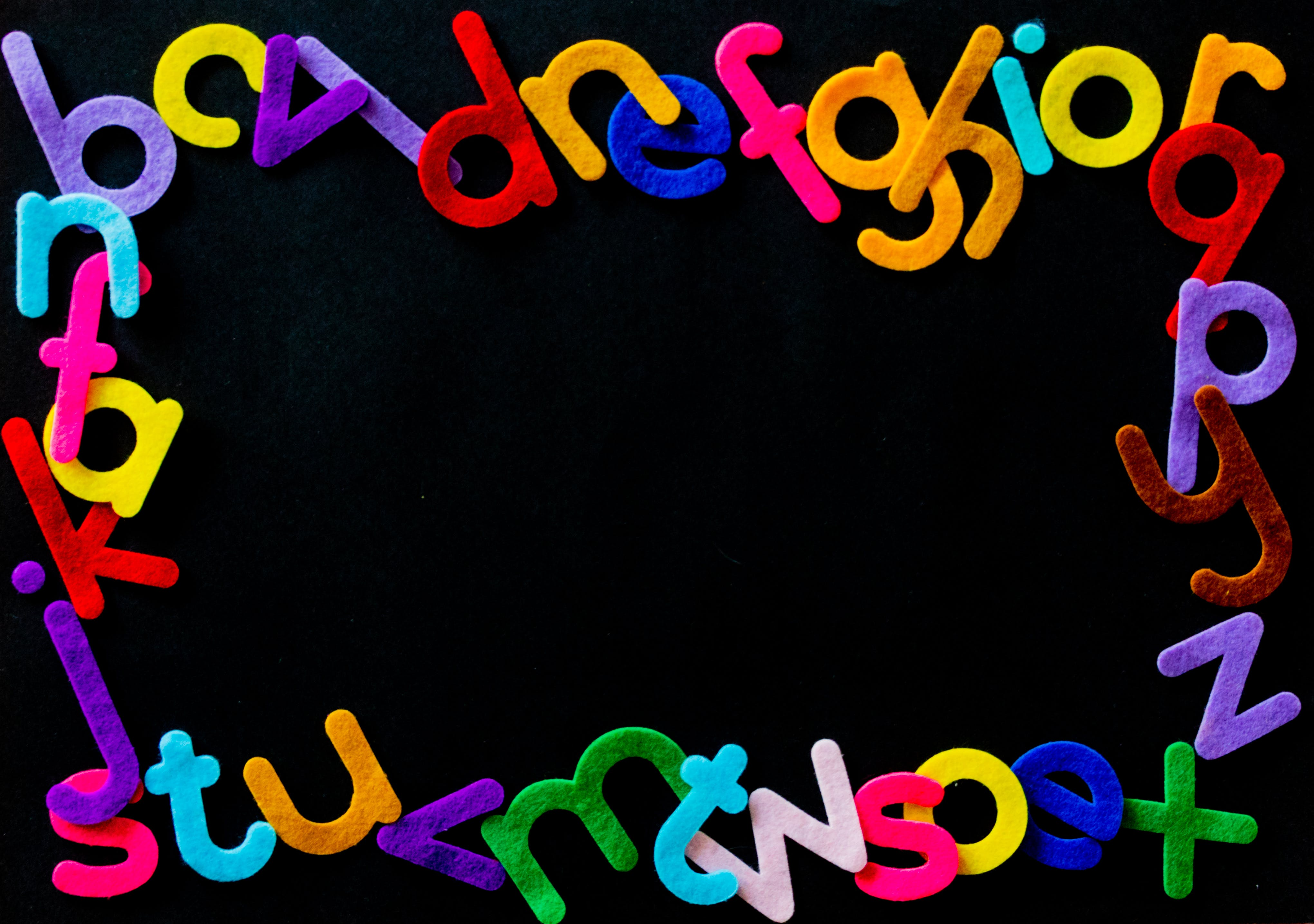 Black Background With Alphabet Letters Text Overlay