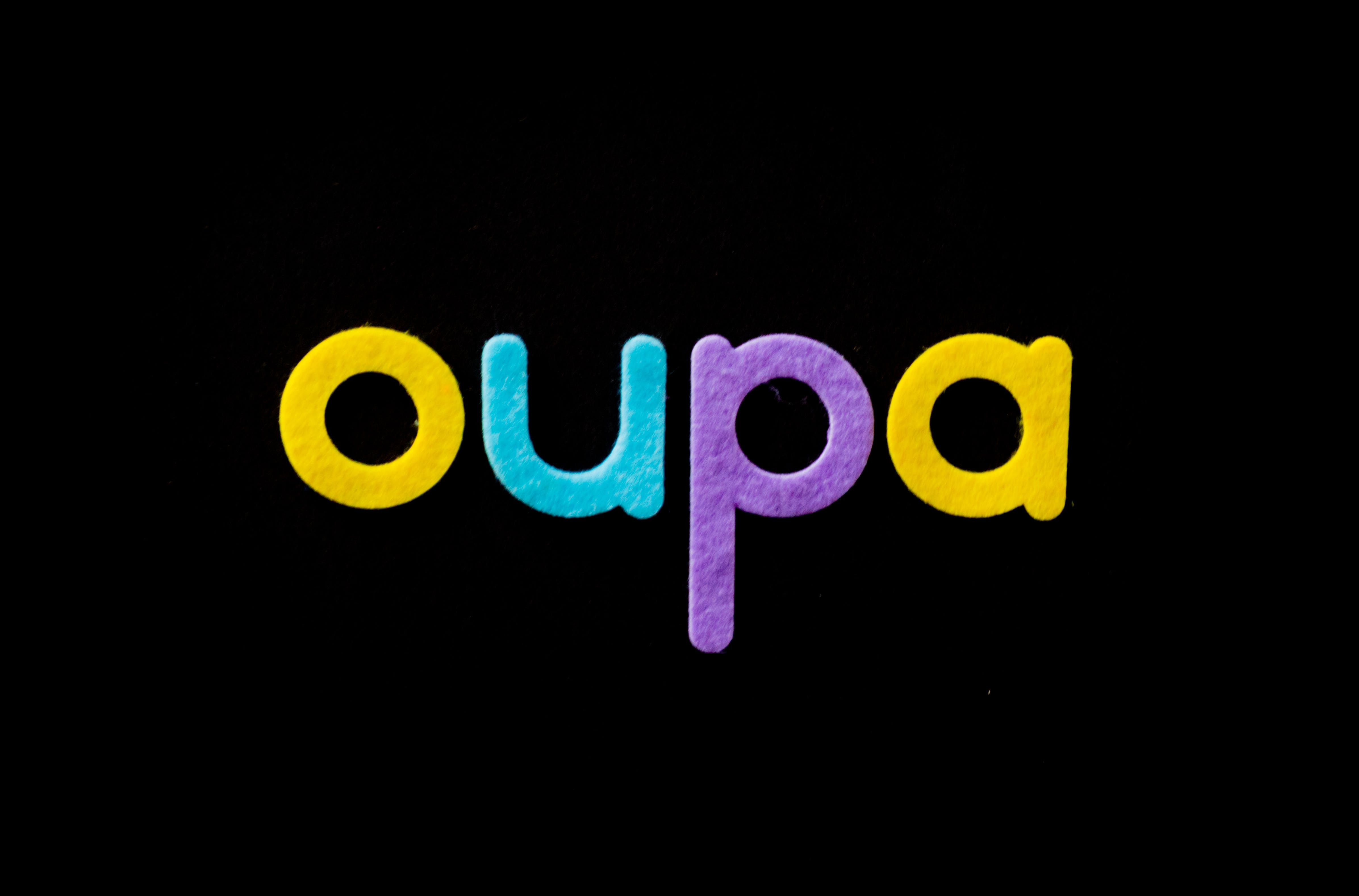 Black Background With Oupa Text Overlay