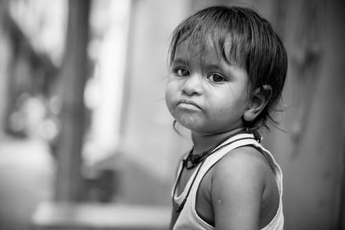 Grayscale Photo Of Child Frowning