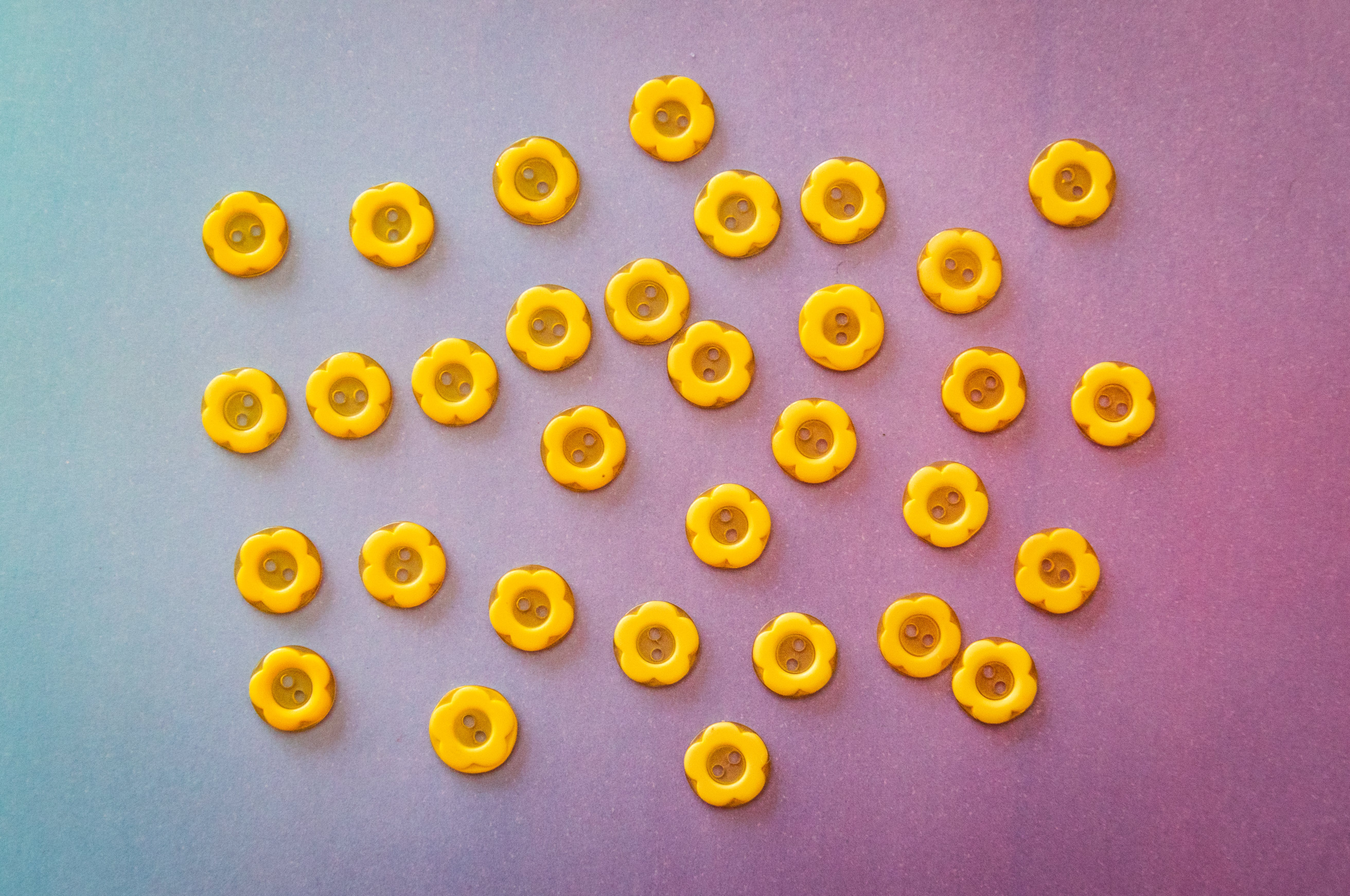 Photo of Yellow Buttons on Surface