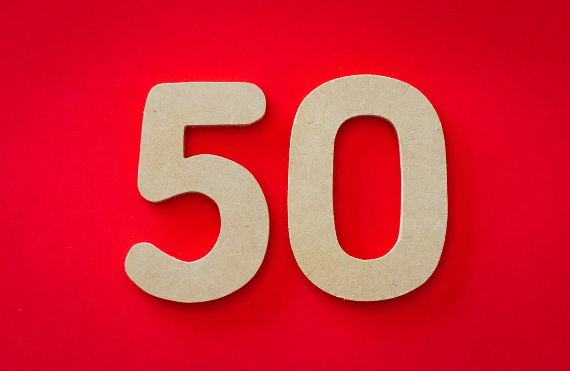 Closeup Photo of 50 Against Red Background