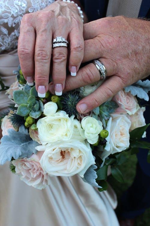 Free stock photo of beautiful flowers, wedding bands, wedding bouquet, wedding ring