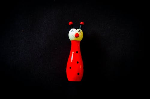Photo of White and Red Ladybug Toy