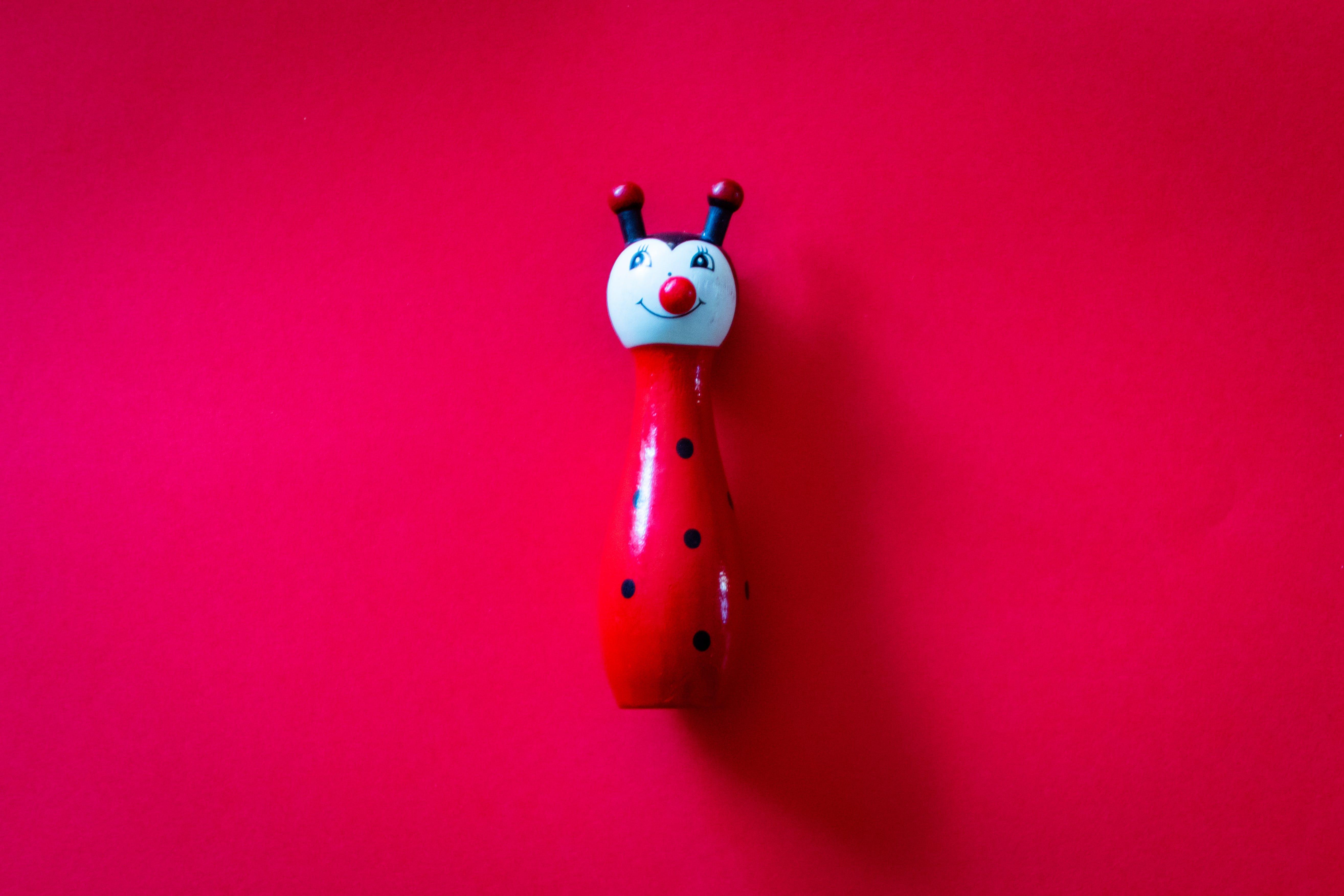 Red and Blue Ceramic Figurine