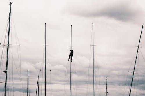 Man Climb on Post