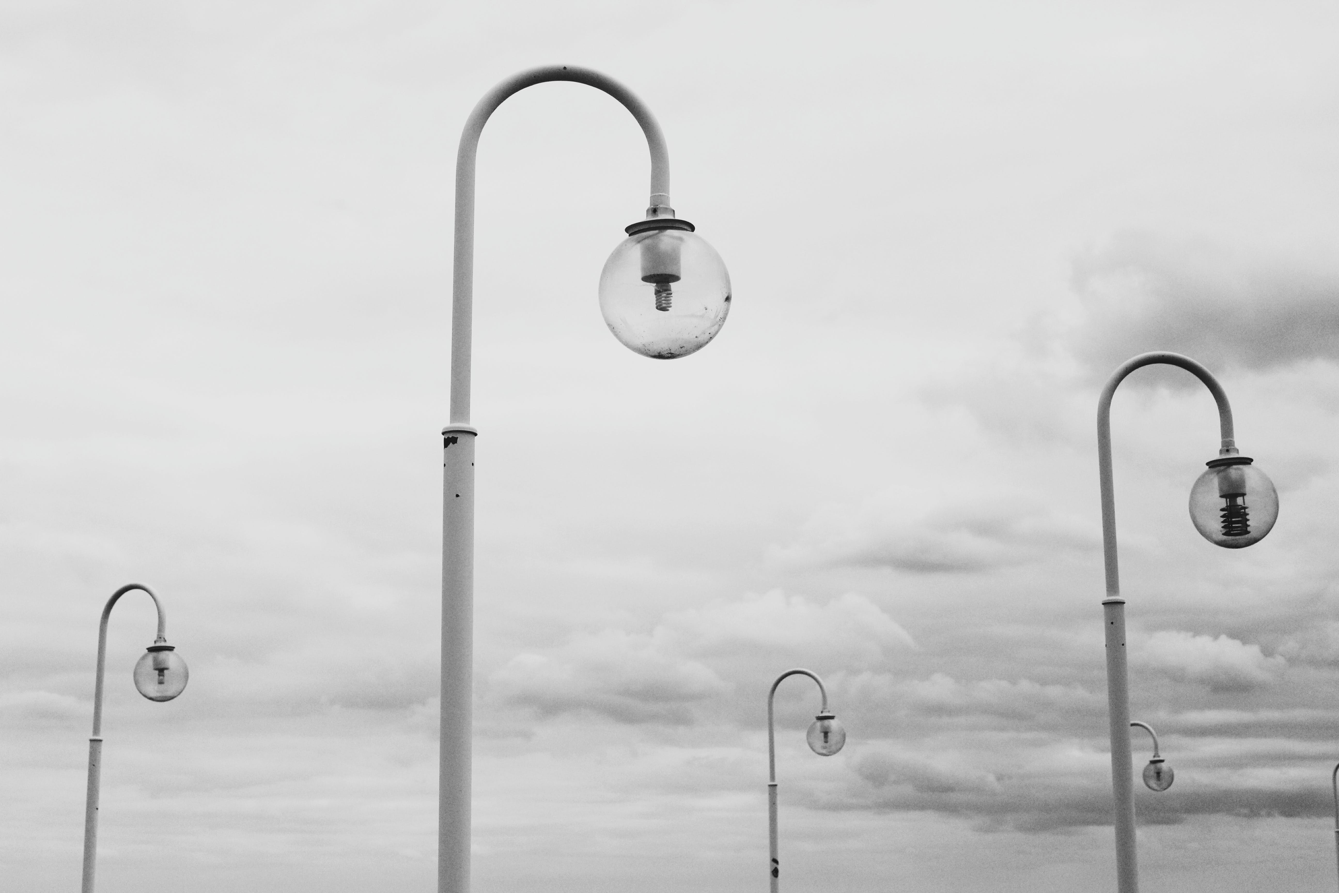 Grey Scale Photography of Lamps