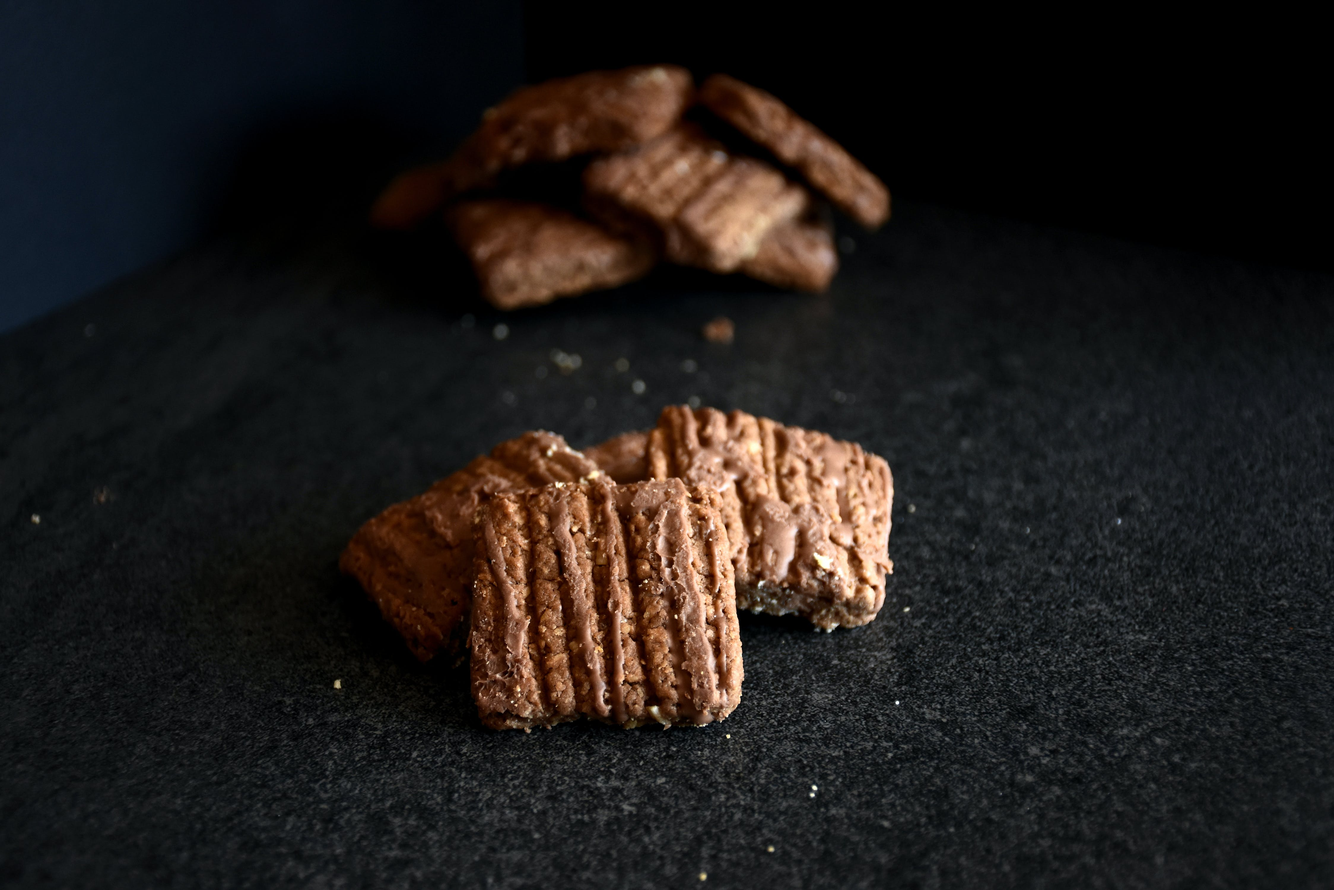 Brown Crackers On Black Cloth