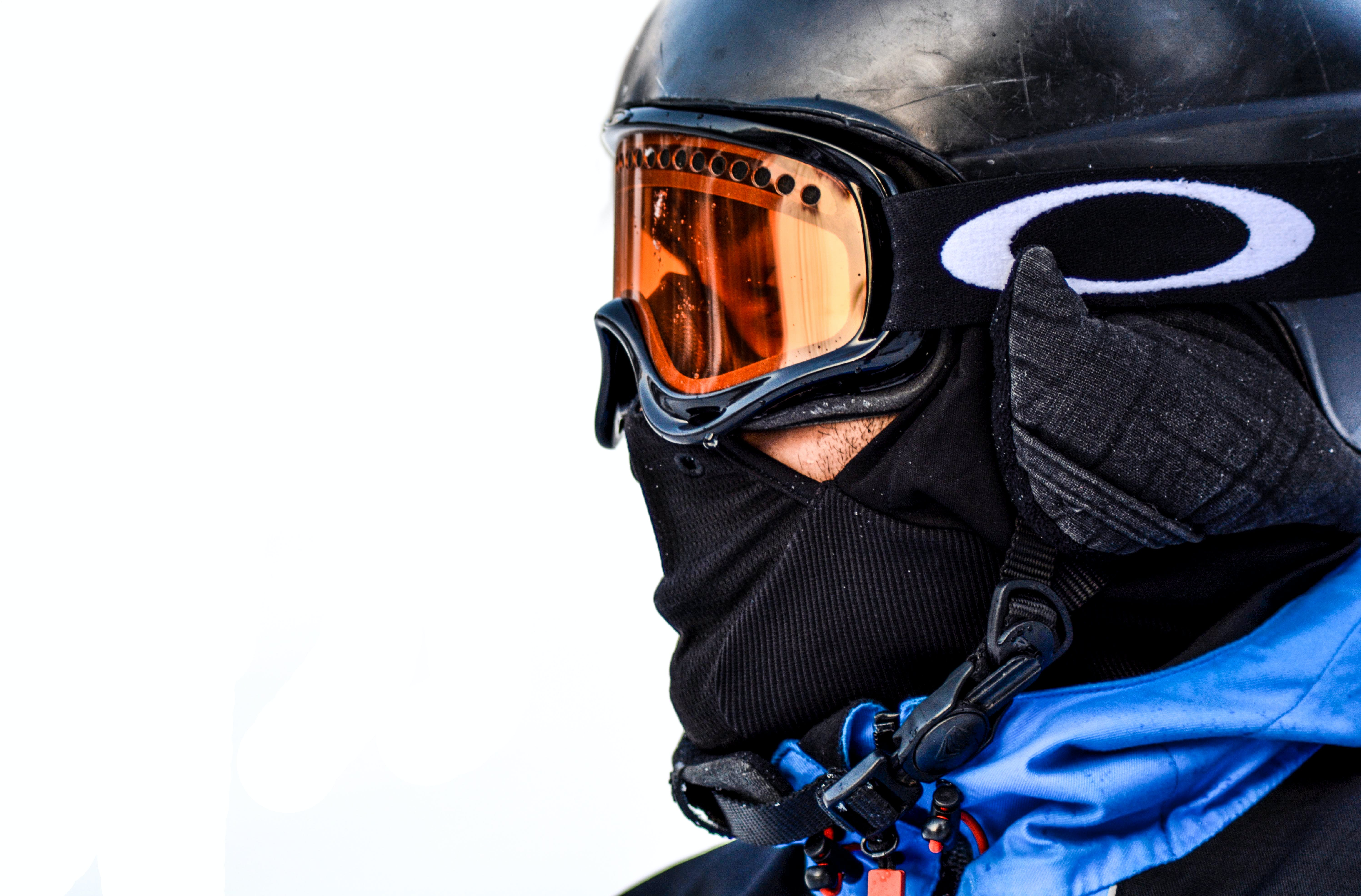 Macro Photo of Person in Black Goggles and Black Face Mask