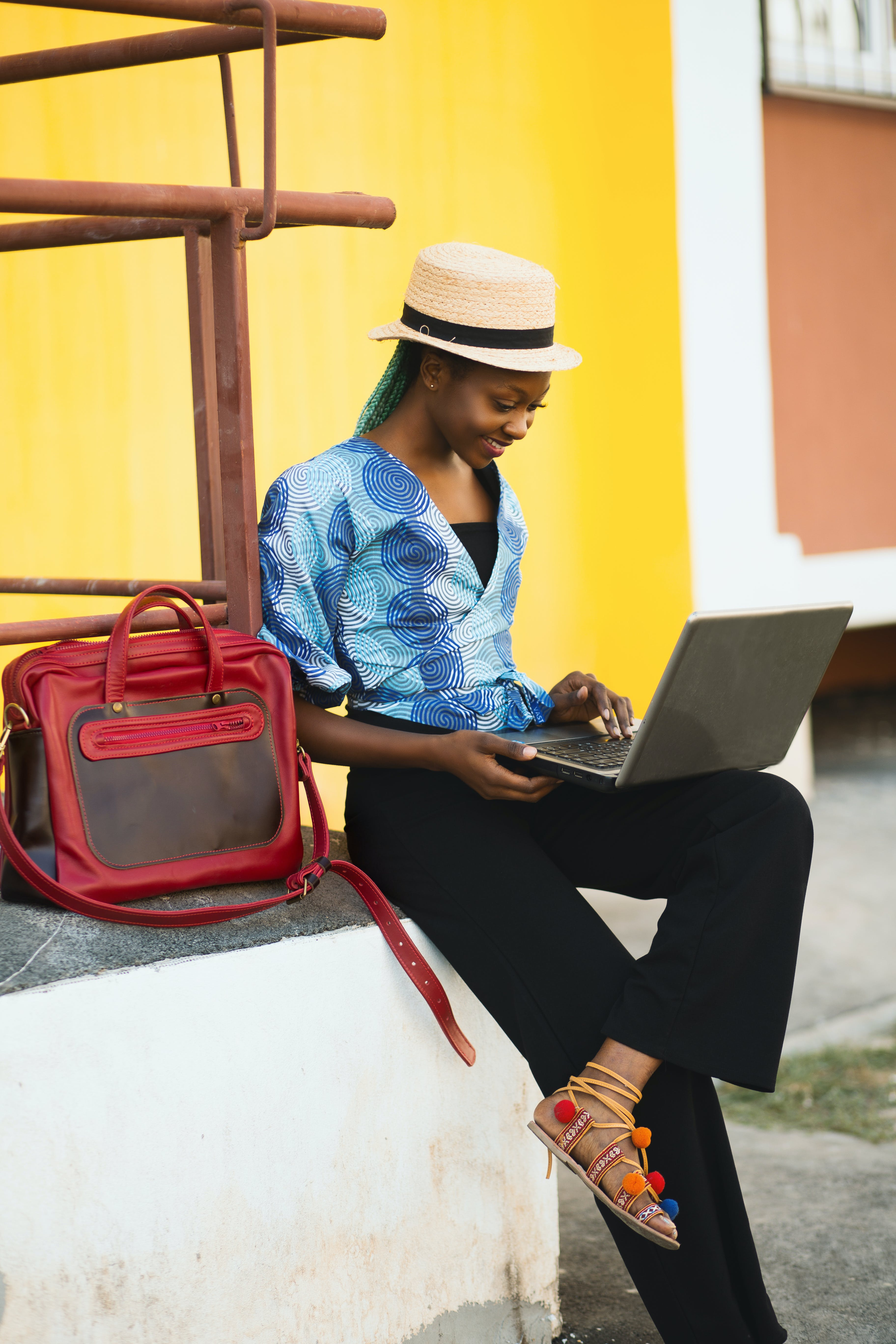 Woman Sitting While Using Laptop Computer