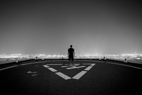Man Standing at the Peak of Helicopter Landing