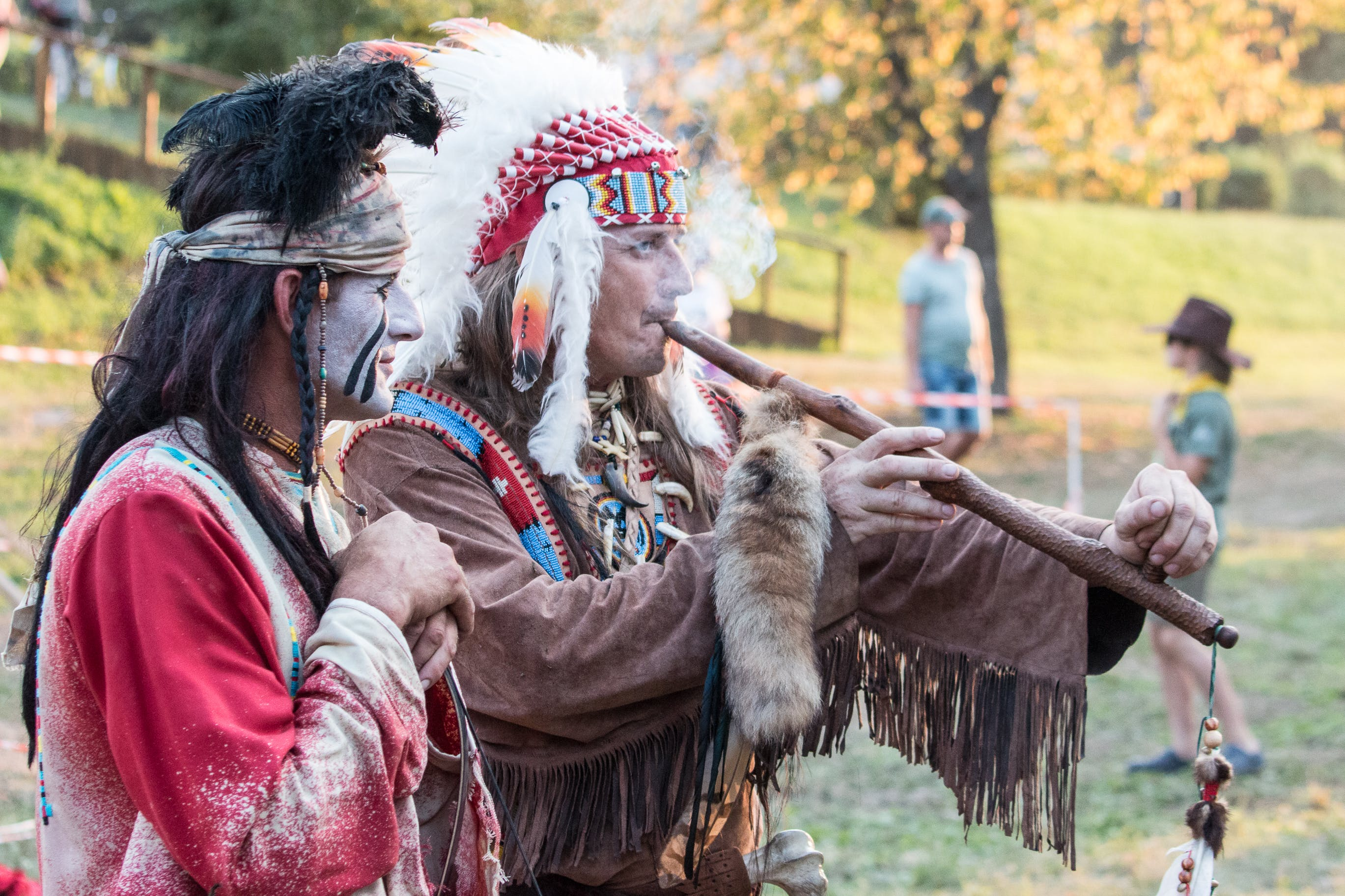 Two Native American Playing Wind Instrument