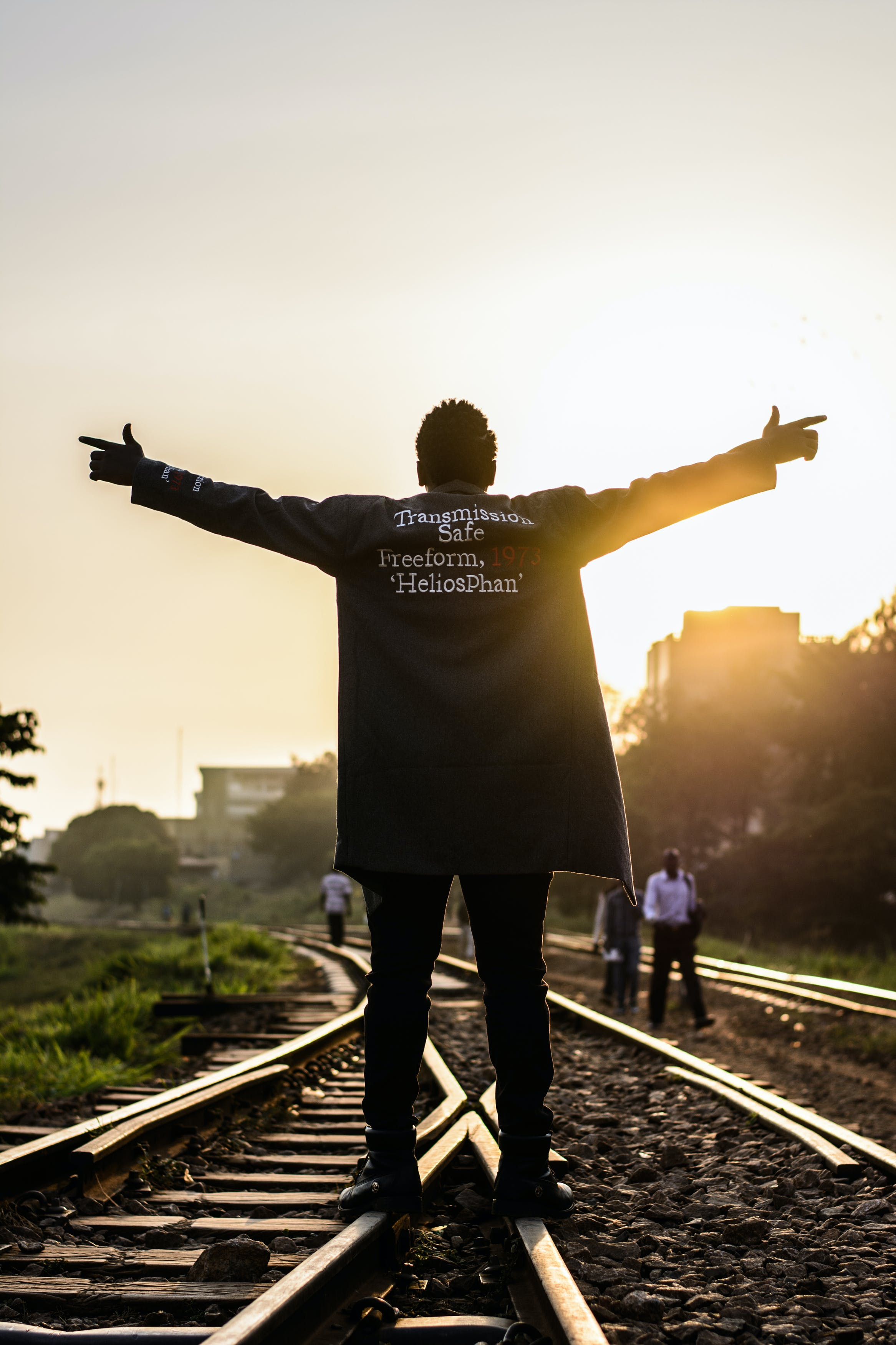 Man Standing On Railway Raising Hands
