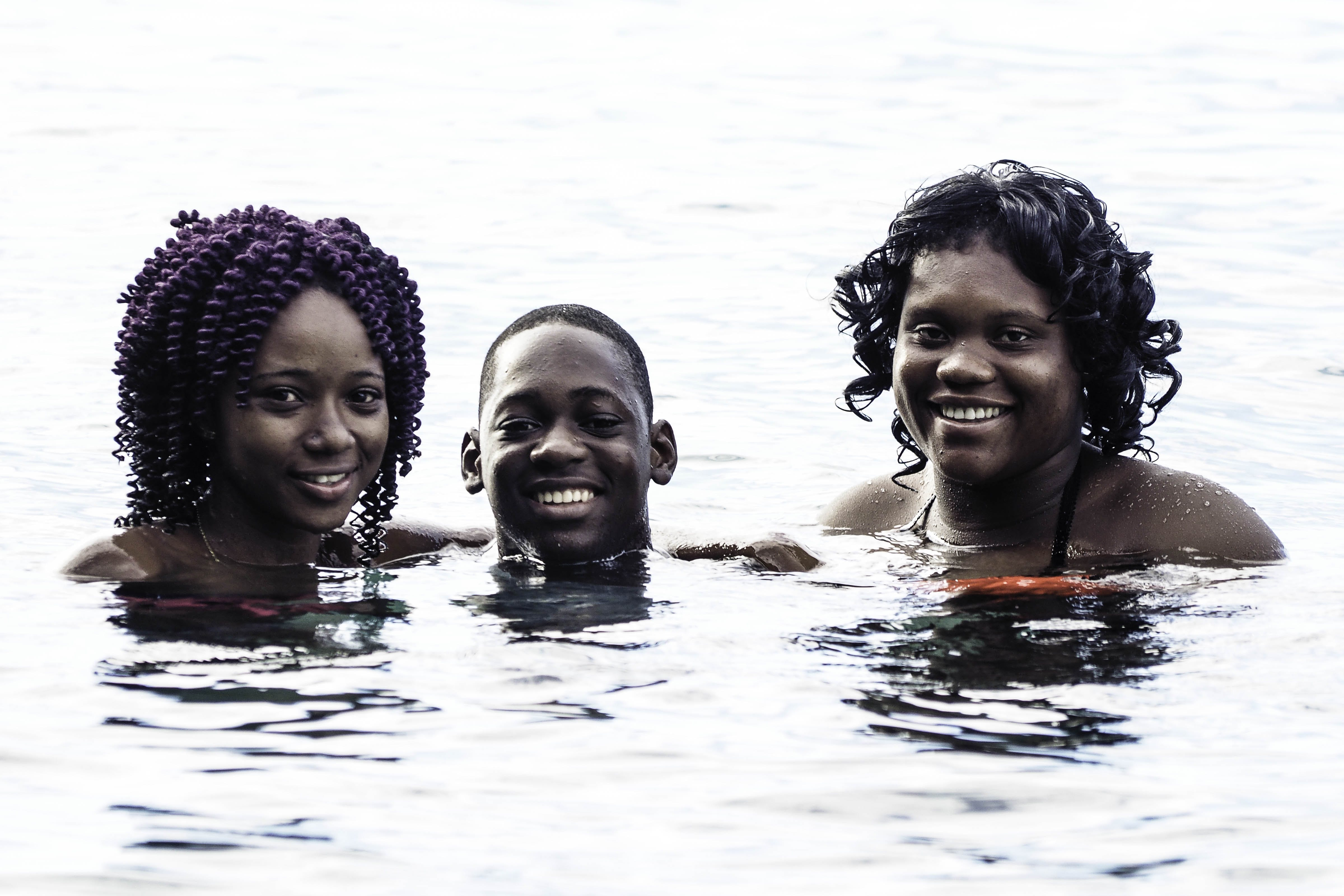 Man And Women Soaking In Body Of Water