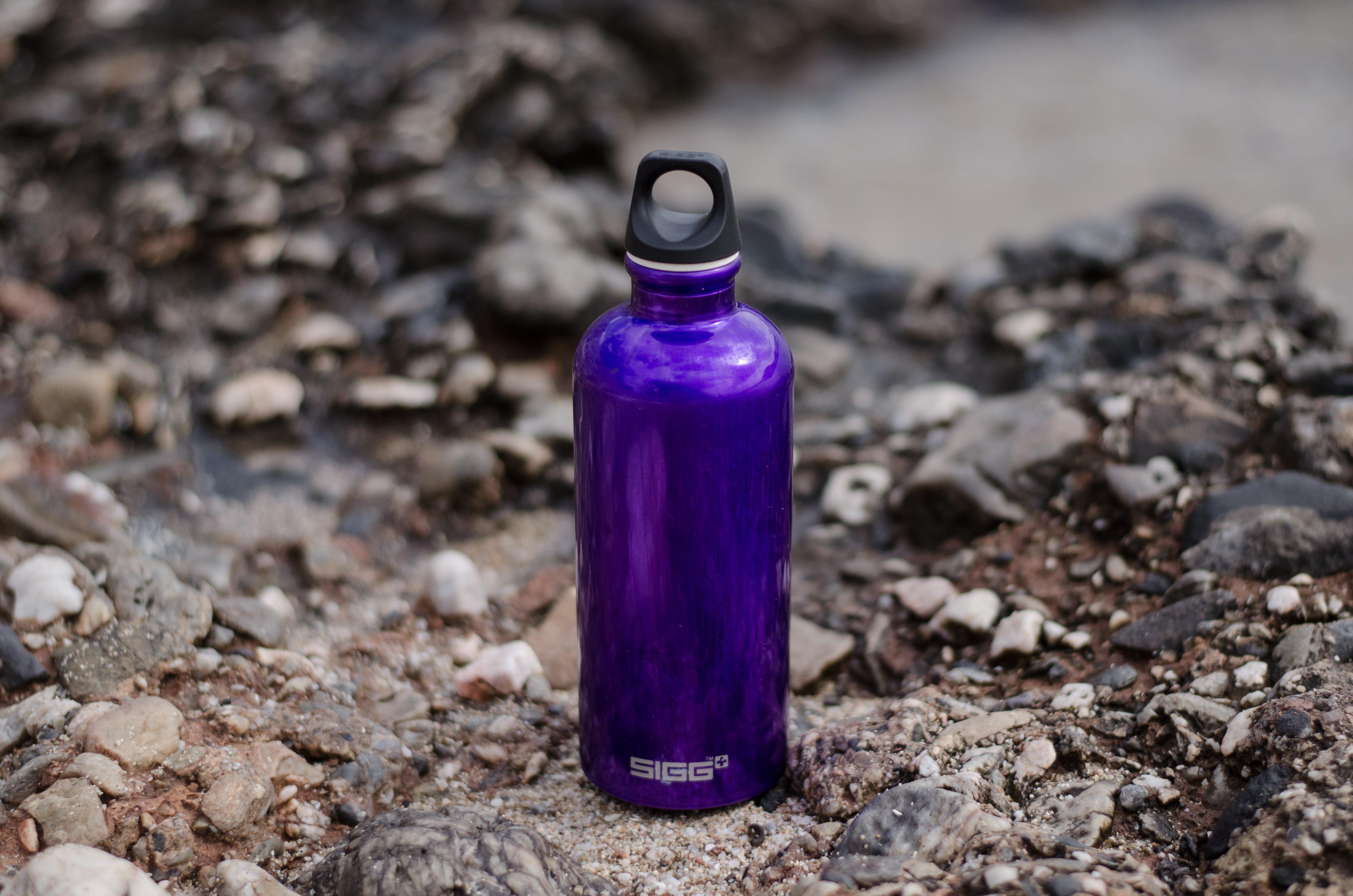 Purple Sports Bottle on Ground