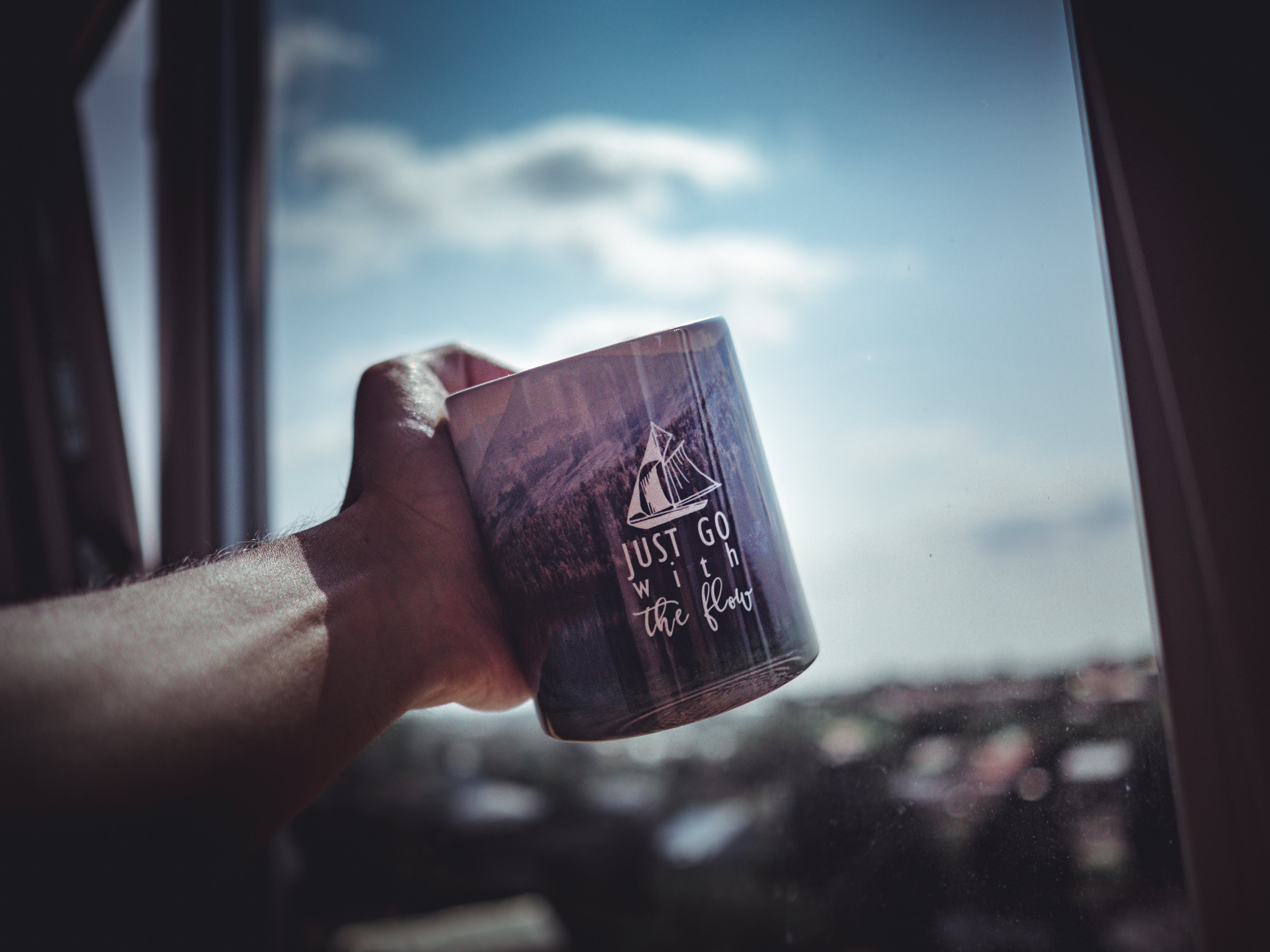 Person Holding Ceramic Mug
