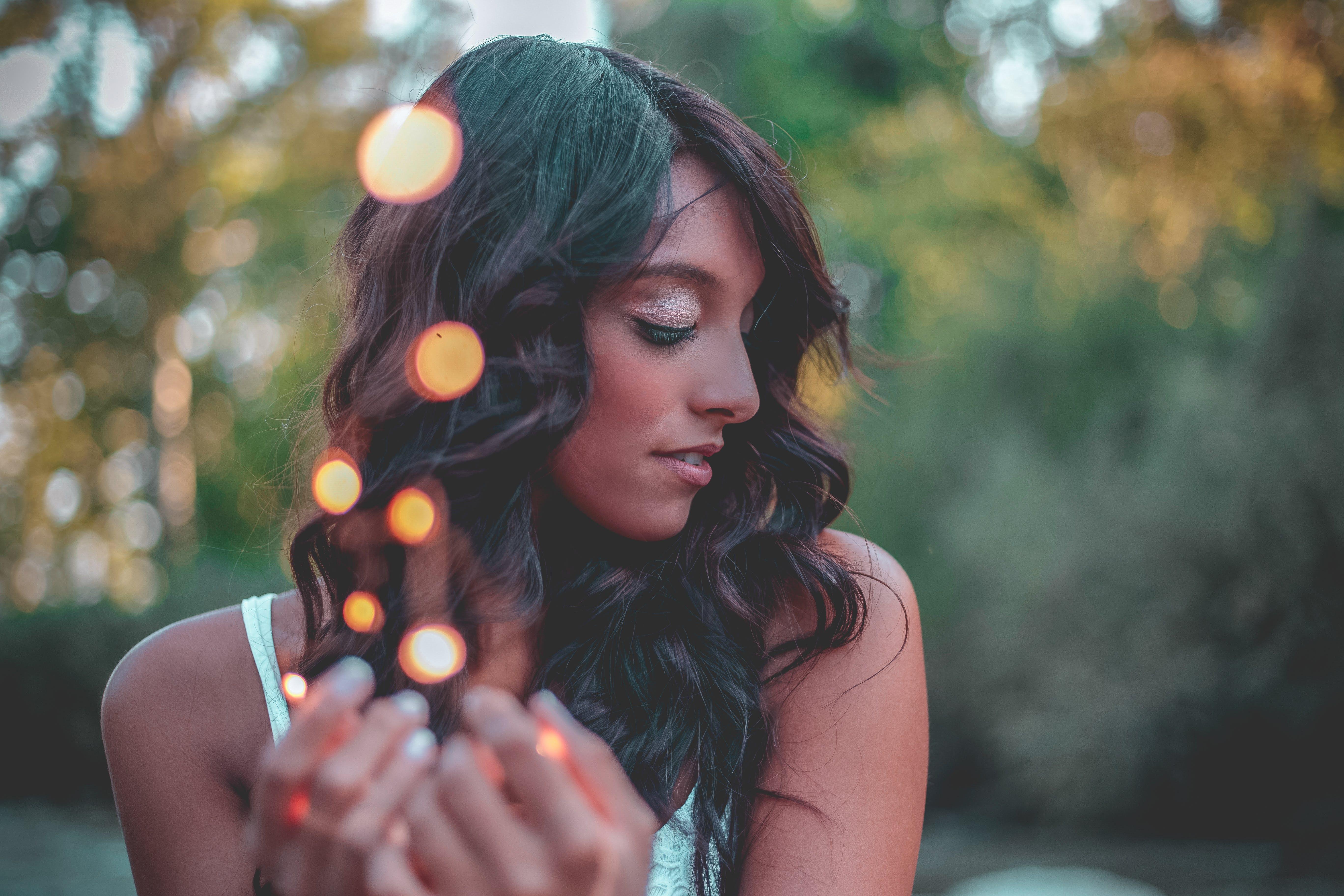 Closeup Photography of Woman Wearing White Spaghetti Strap Top