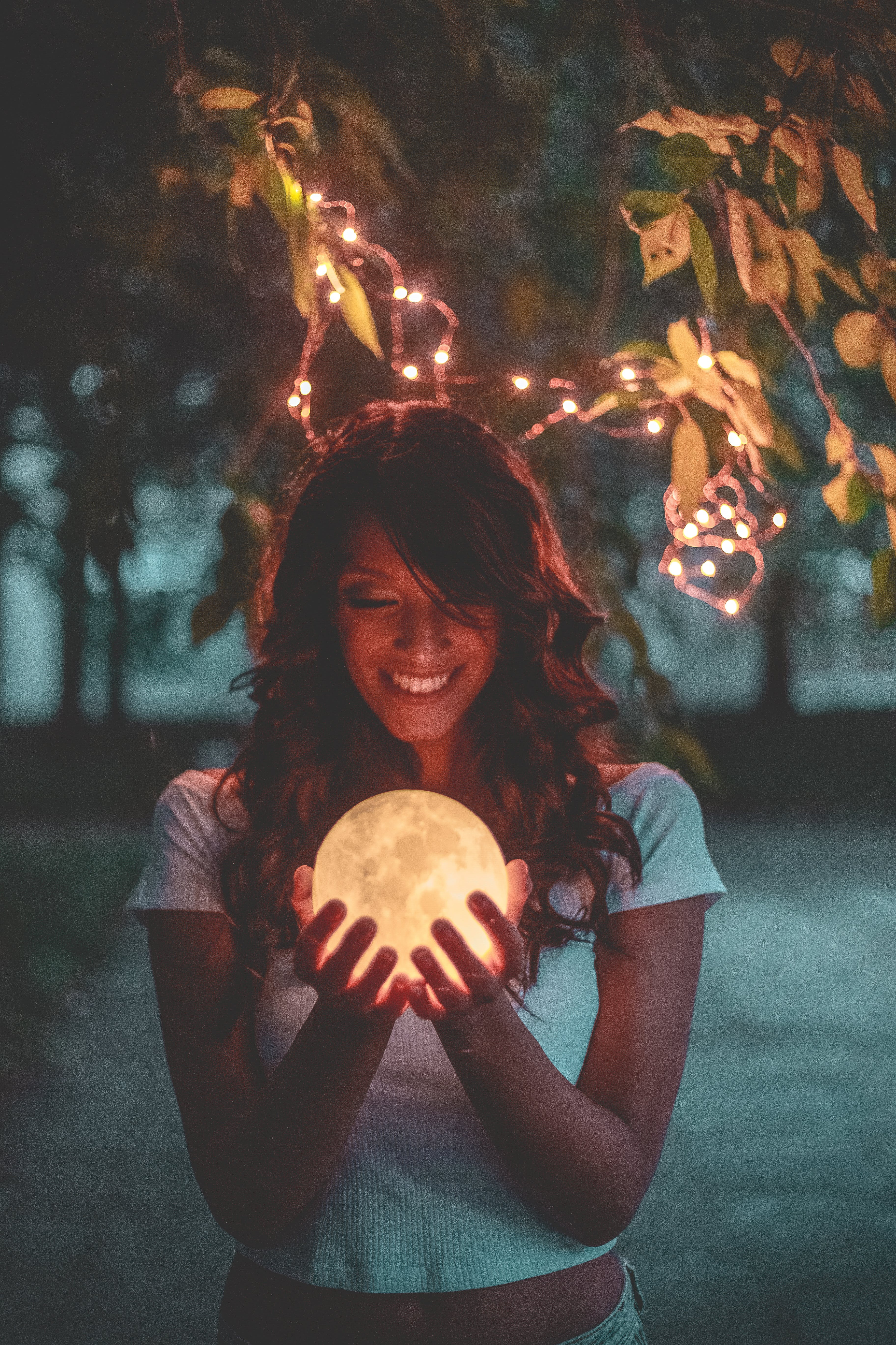 Smiling Woman Holding Moon