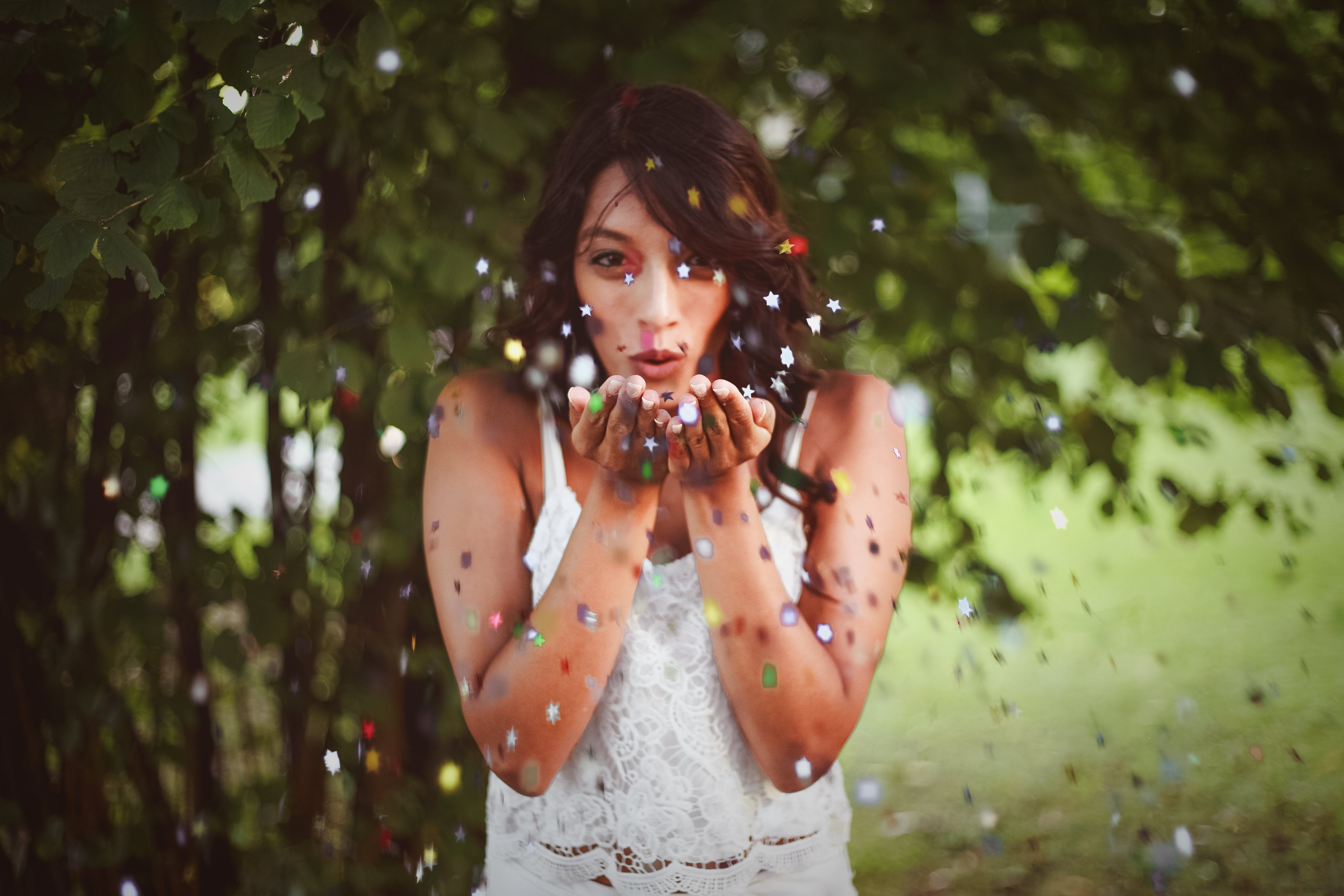 Woman Blowing Glitters On Her Hands