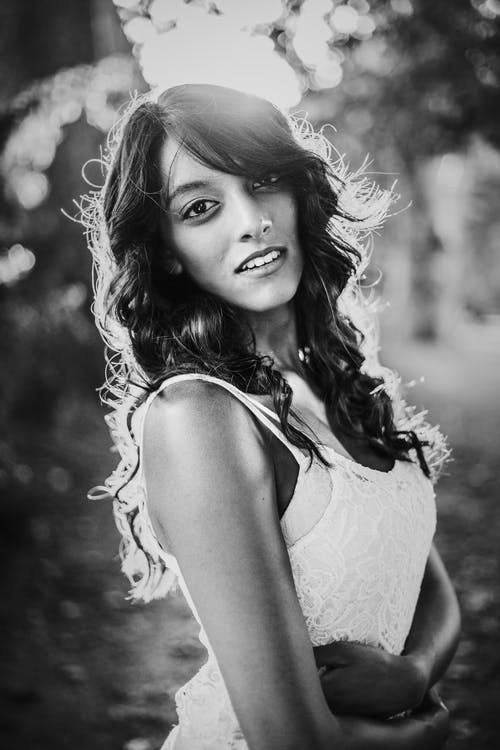 Grayscale Photography Of Woman Wearing Lace Sleeveless Top