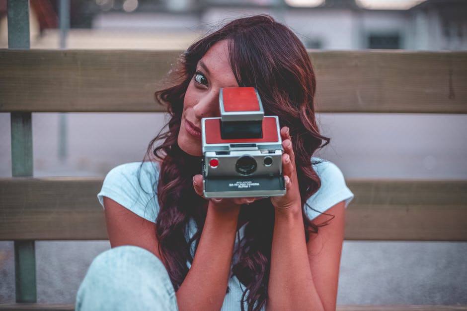 Woman Holding Red Camera