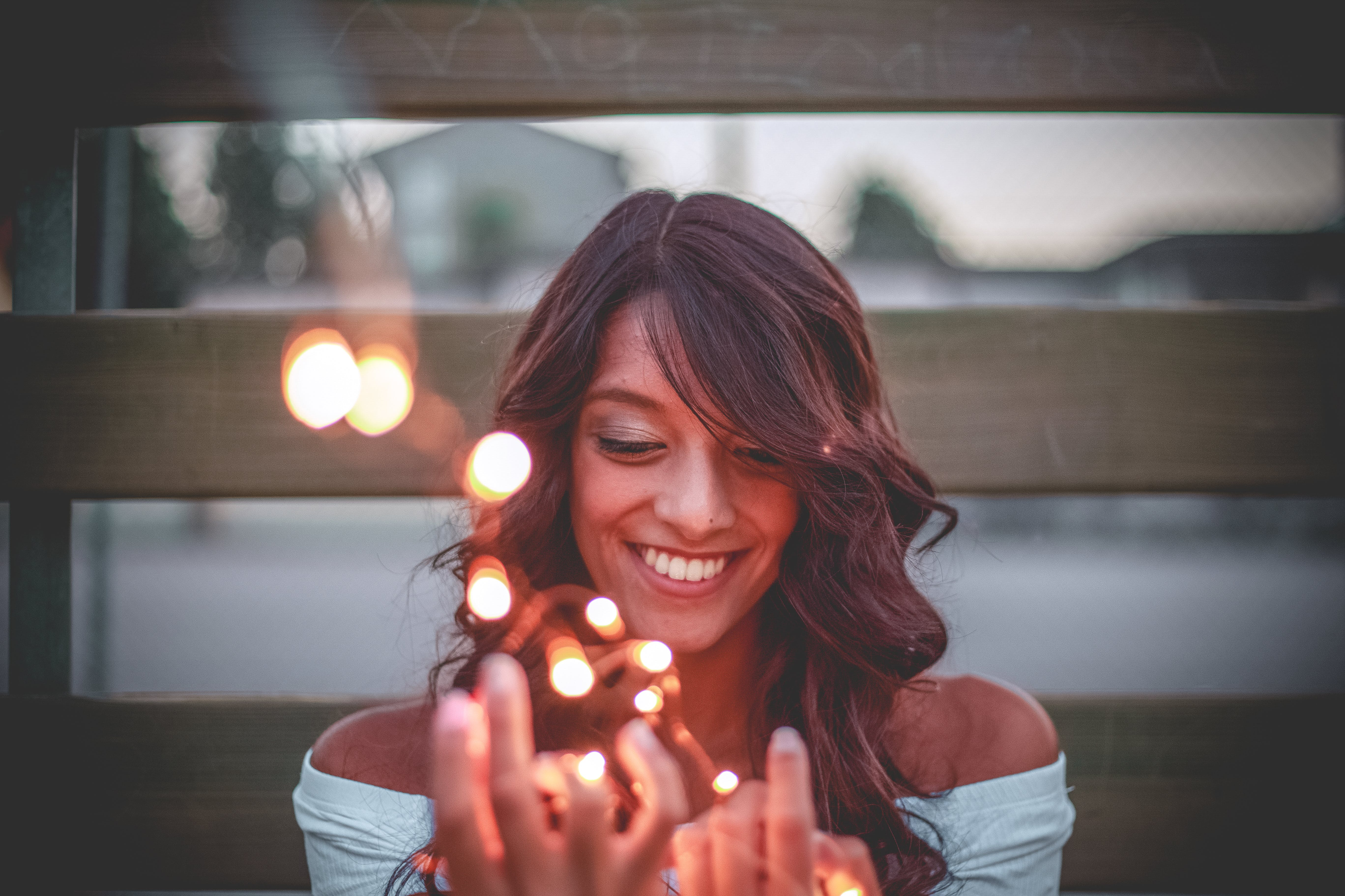 Selective Focus Photography Of Smiling Woman Holding String Lights